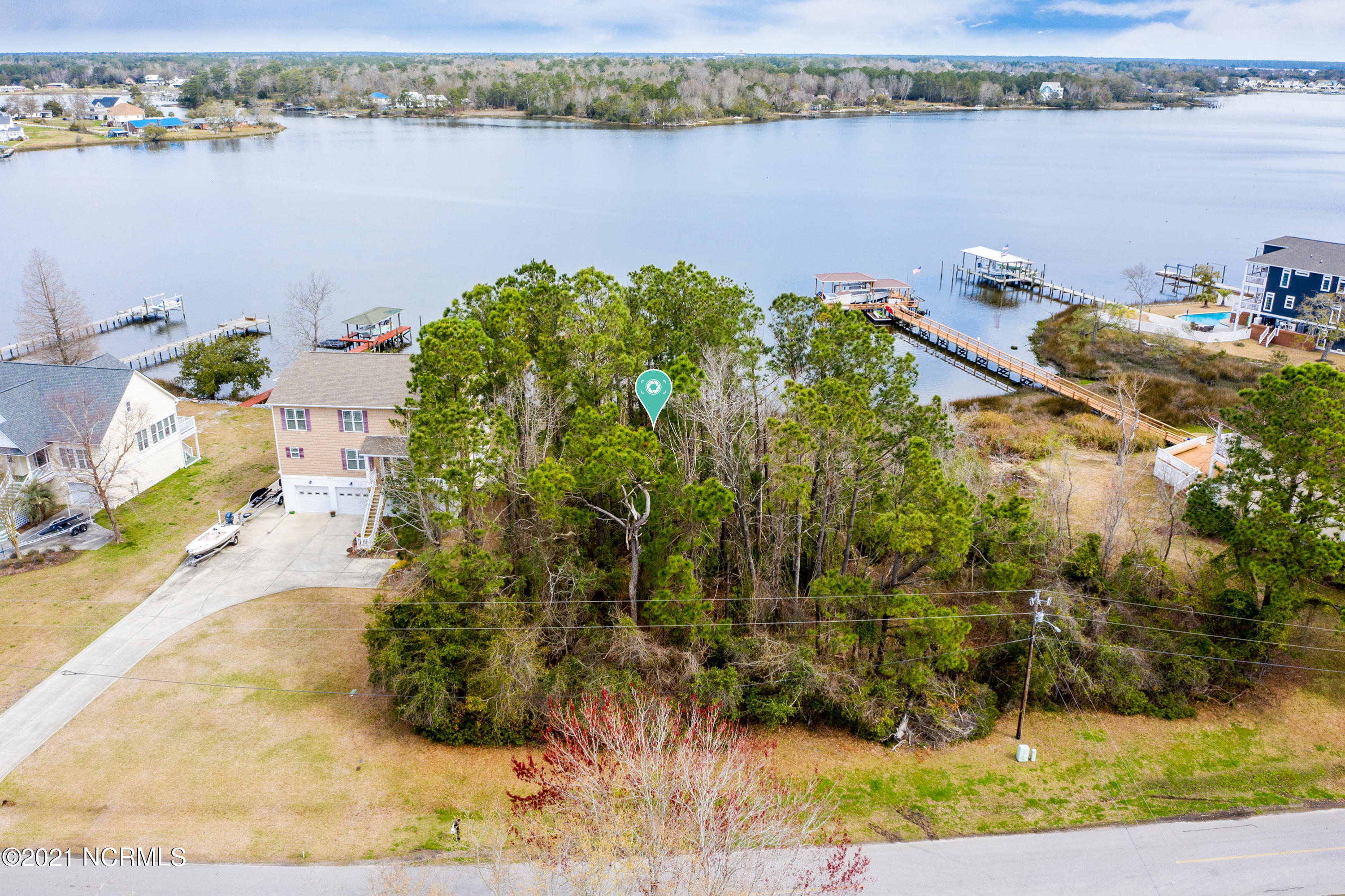 Don't miss this beautiful waterfront lot with picturesque views of Fullard Creek.  Located in an AE flood zone this is the perfect spot to build your dream home. Chadwick Shores is a gated community that offers a playground, picnic area and day dock for your enjoyment.