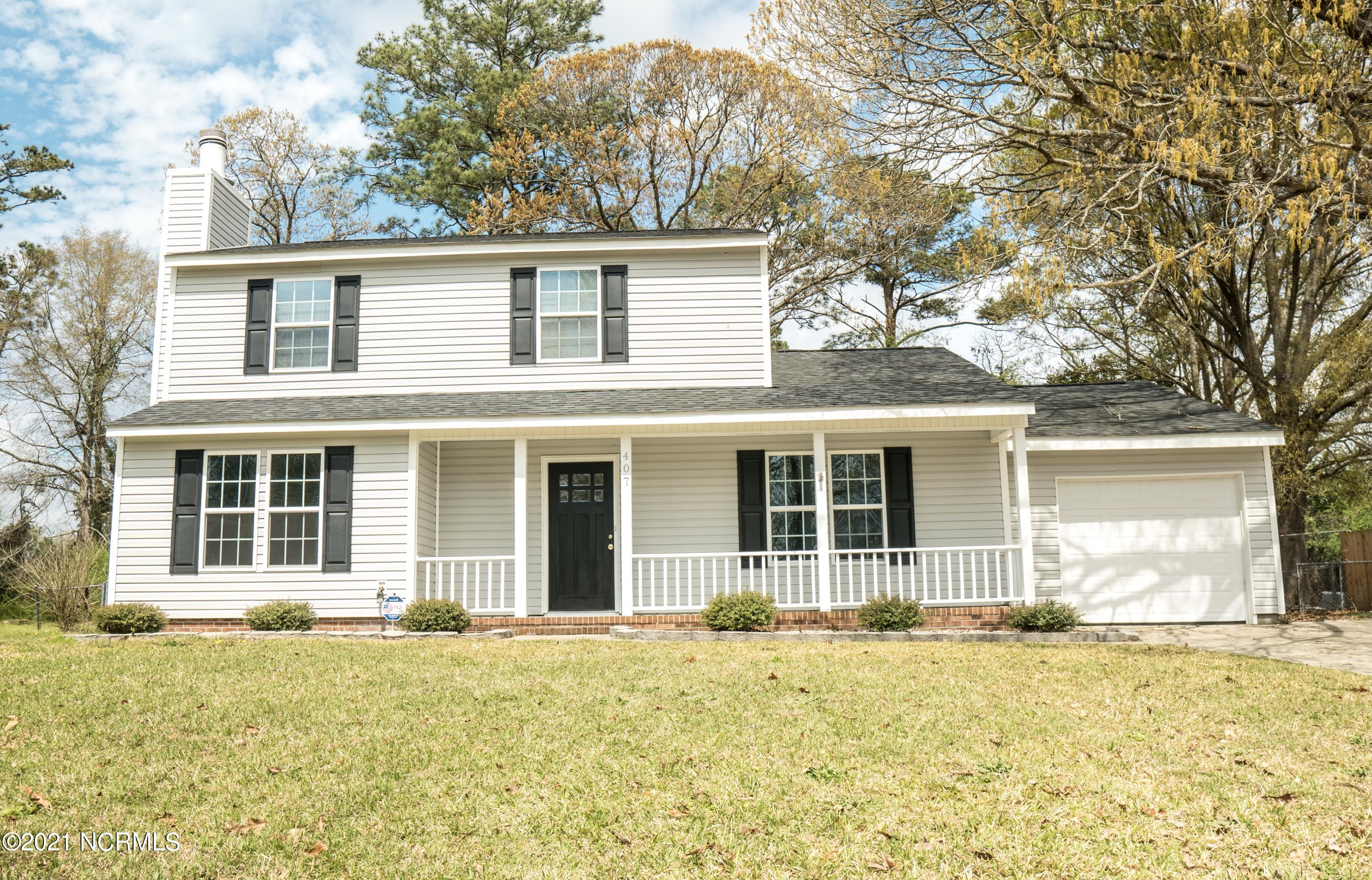 Welcome to your new home! Conveniently located in Montclair off of Piney Green Road close to Camp Lejeune, beaches, and shopping. This beautifully remodeled home has a brand new HVAC, new cabinets and countertops, and stainless steel appliances. Featuring a bonus bedroom downstairs perfect for house guests to have privacy, a den with a brick fireplace, and an oversized sunroom great for entertaining! NO city taxes and no HOA. Schedule your tour before this home is gone!