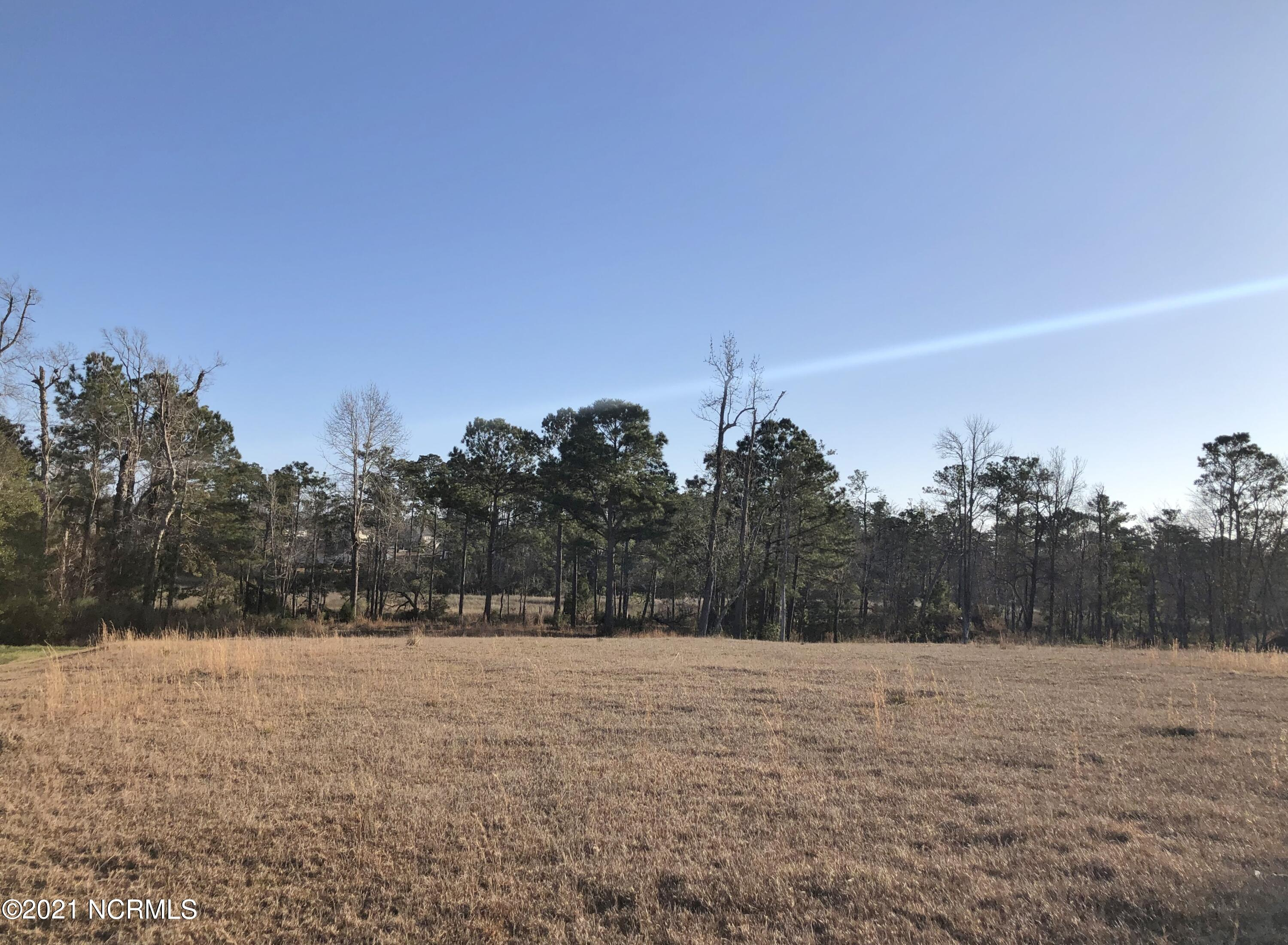 Nearly two acres in Swansboro! This large residential building lot is located on a cul-de-sac in the wonderful neighborhood of Halls Creek North. Approximately 260+/- ft fronts the marsh and creek. Great for kayaks! Imagine building your new home with a magnificent view of nature. Call for more information.
