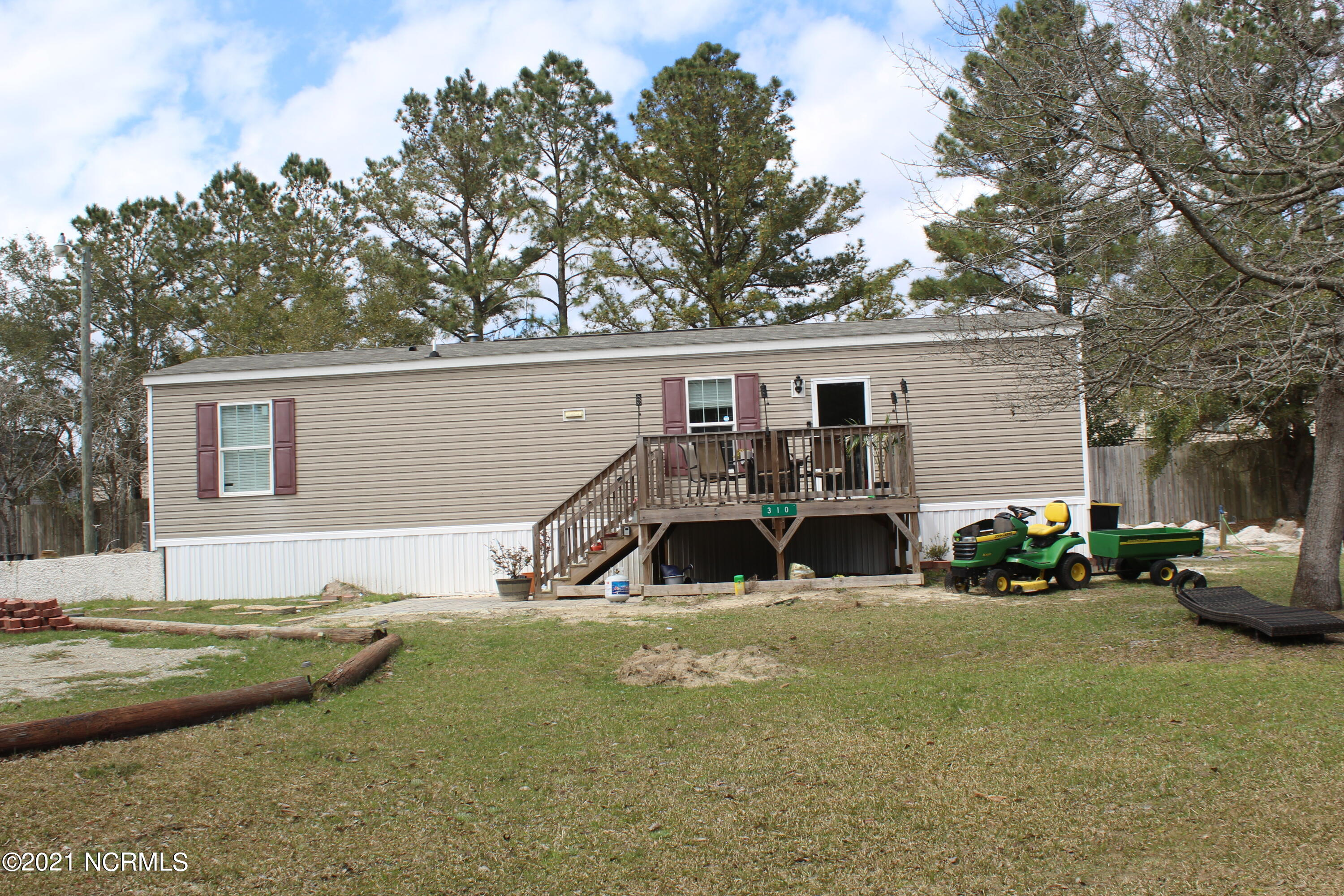 Two bedroom single-wide home nestled into a private 2.8 acre cleared lot, providing plenty of space and privacy. Perfect for a mini farm and all kinds of quiet outdoor country living! Conveniently located to the beach, Jacksonville, and Wilmington.
