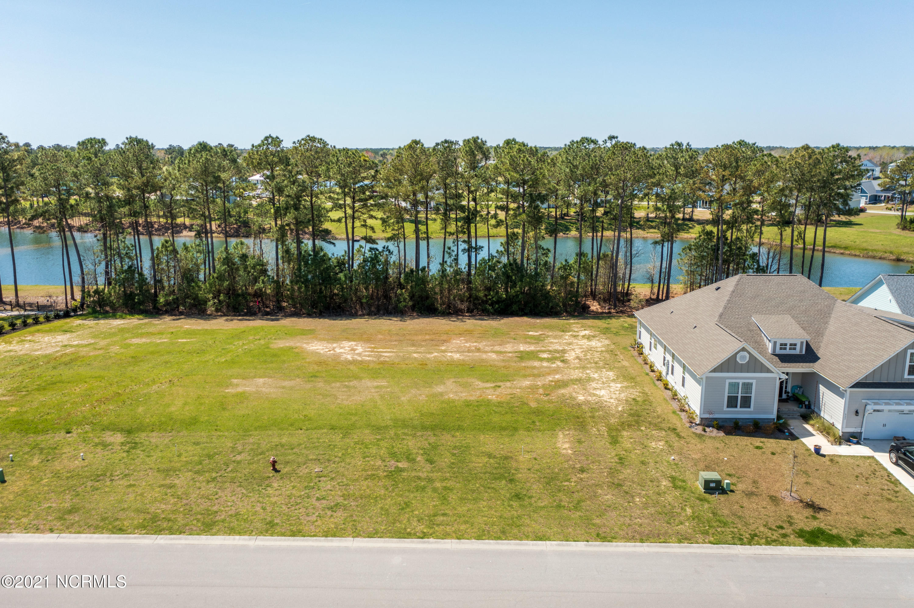 Waterfront lot on Moss Lake Ln in the gated waterfront community of Summerhouse on Everett Bay is waiting for you and your design. Come build your dream home in this coastal community near Topsail Island. The Atlantic Ocean and the ICW offer many boating opportunities from the ramp and dock which are part of the amenities of this property. They also offer large clubhouse with a swimming pool around it, tennis, workout facility, trails for walking or biking plus a day dock. This lot backs up to one of several lakes on the grounds of Summerhouse on Everett Bay. Come check it out!