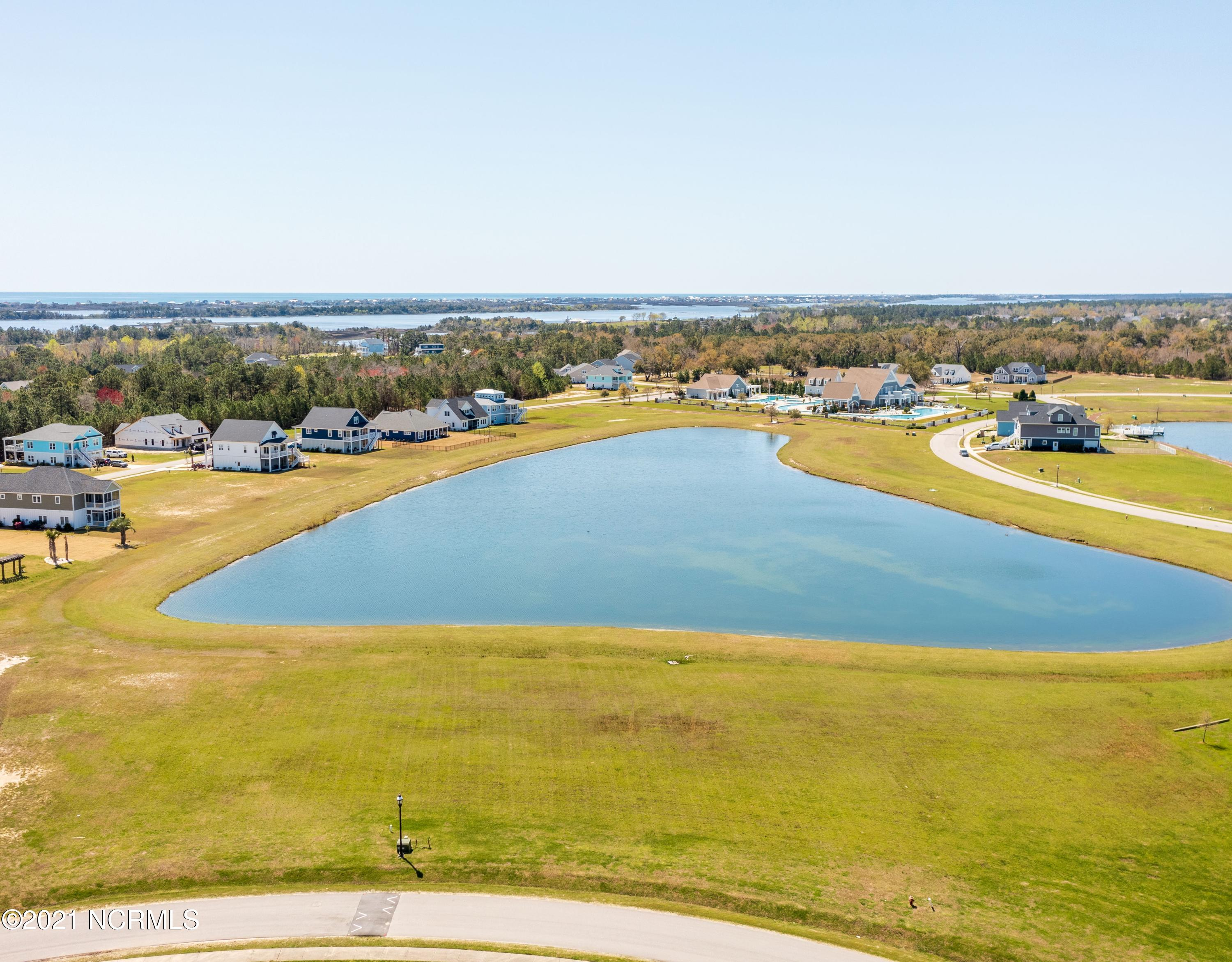Don't miss this lake front lot on Moss Lake Lane with the perfect view of the clubhouse in the gated waterfront community of Summerhouse on Everett Bay.  It is waiting for you and your design.  Come build your dream home in this coastal community minutes from Topsail Island.  The Atlantic Ocean and the ICW offer many boating opportunities from the ramp and dock which are part of the amenities of this neighborhood.  Large Clubhouse, community pool, tennis, workout facility, nature trails, boat storage plus a day dock.  Short distance to the beaches, Camp Lejeune, Wilmington or Jacksonville.  Come check it out!!