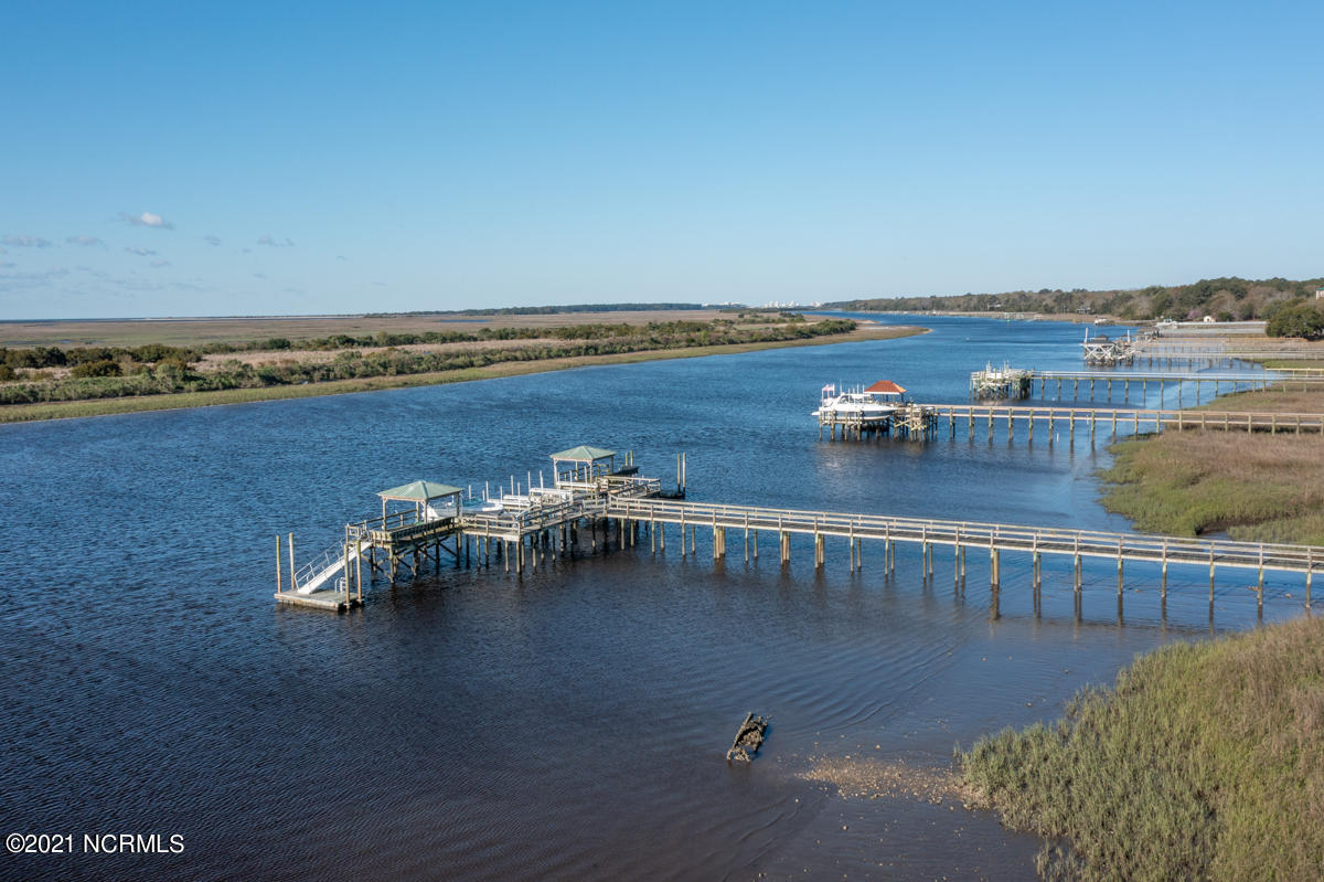 Waterfront in stunning Sunset Beach! Looking for the perfect place to build your dream home? Don't miss this 0.3 acre homesite featuring serene intracoastal views with pier and boat dock access. Dock fee is $1000 per year. Less than 5 minutes to beach access, dining, shopping, and summer activities. Ready for your dream home!