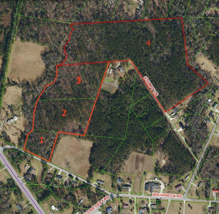 Four parcel portfolio includes a total of 32.53 wooded acres. Approx 311 feet of road frontage on Briarneck Rd, Jacksonville NC.   Zoned RA