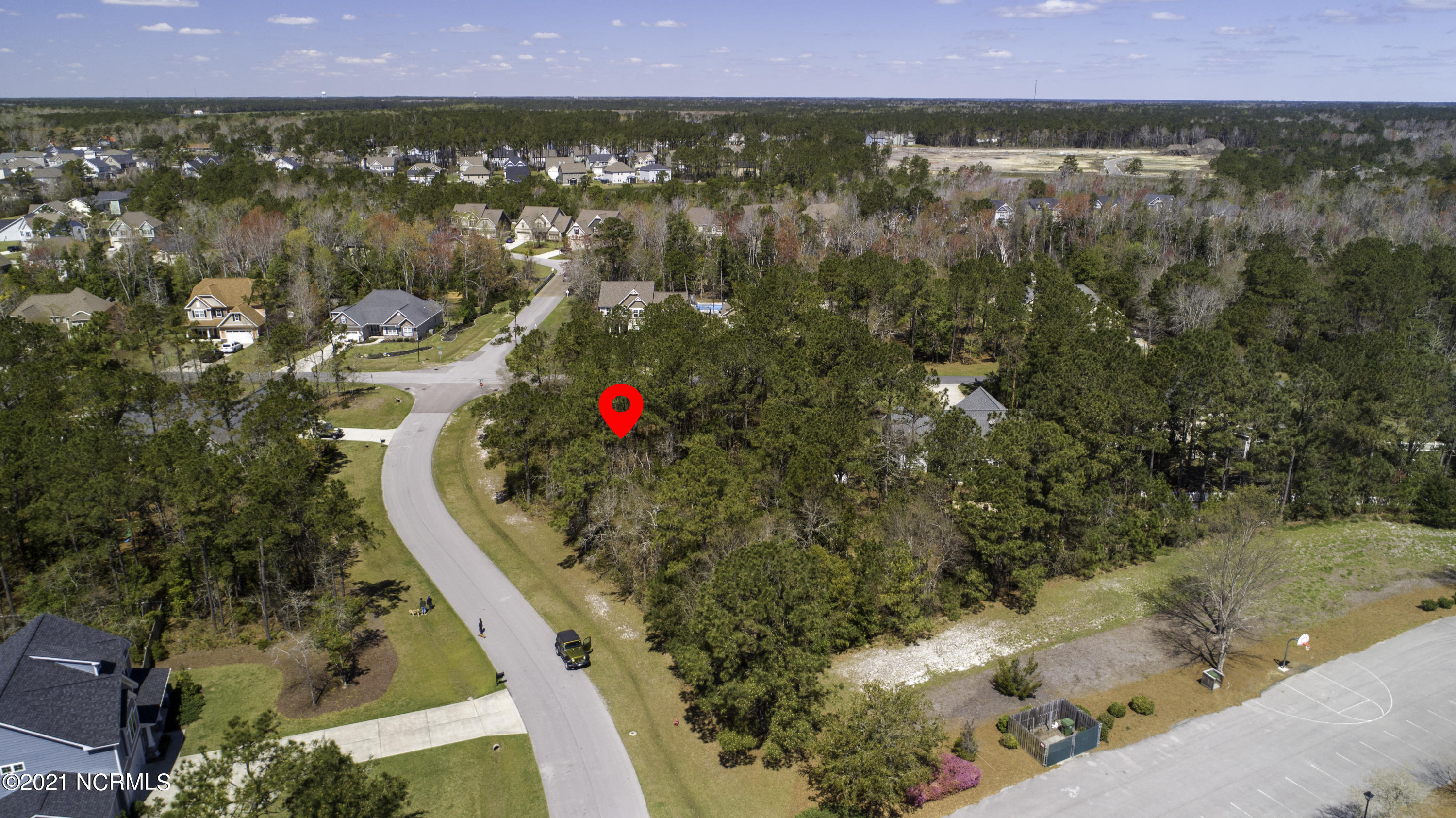 *PRICE REDUCTION* Absolutely beautiful corner lot in Mimosa Bay waiting for you to build your dream home. The community offers a clubhouse, dock, fitness center, pool, and walking trails. Water and sewer available. Nice neighborhood just minutes from the ocean, shopping, restaurants, medical offices, dental offices, vet services for your fur babies! It's all here. Bring your plans and walk this property. You will be glad you did.