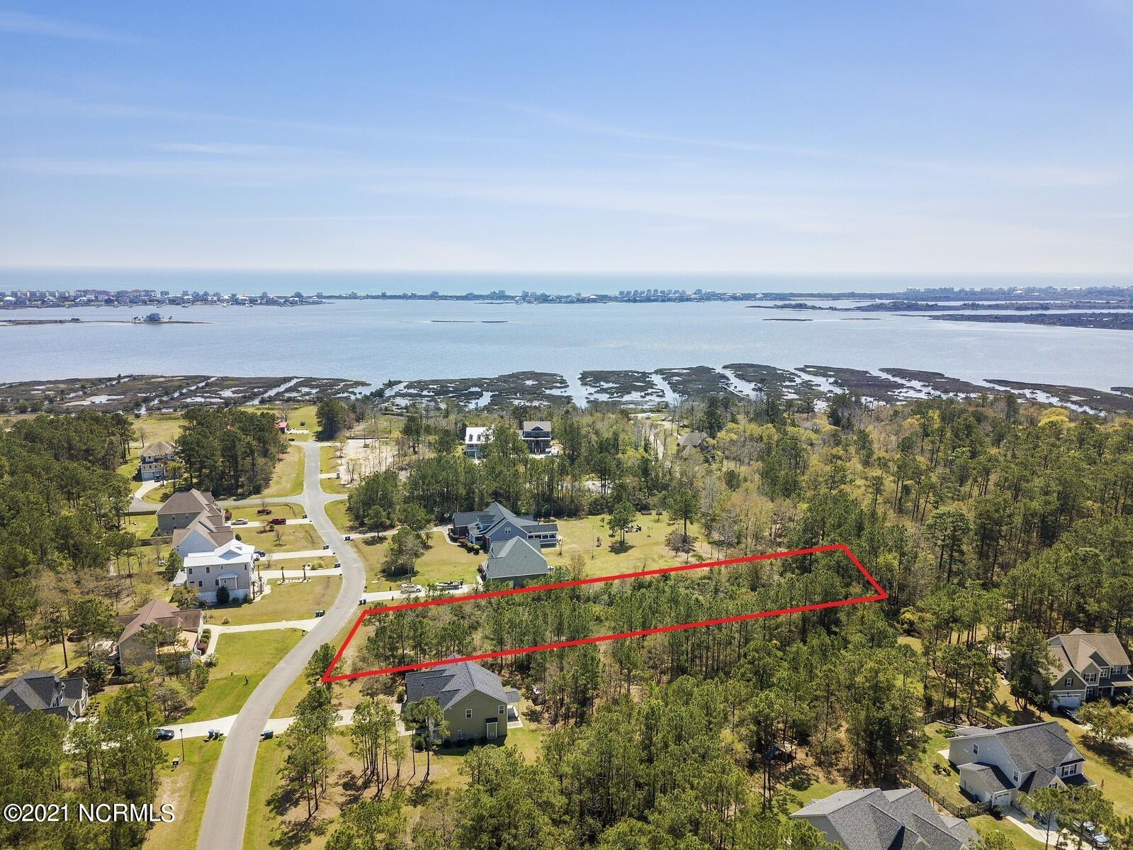 Here's your chance to build your dream home in the desirable, gated, waterfront community Mimosa Bay on the largest, best priced lot available! Situate your home on over an acre with plenty of yard and space from your neighbors... will you go with a ranch or a 2 story home? Contemporary or Coastal Cottage? Sewer and County Water are available to tap into, and the HOA will work with you on the perfect plan and design to fit into the neighborhood. By the way, you don't need a waterfront lot to use your boat, just launch from the community boat dock and you're off for a fun day on the water, park it at the storage lot and keep your driveway clear. Lounge by the swimming pool and get your daily dose of Vitamin D or work on your serve at the lighted tennis courts, even after dark. Need a place to host a gathering/shower/party so they aren't all at your house? The clubhouse just may be the perfect location for your event. Residents in the community have a playground to frolic on, as well as a boardwalk and picnic area for outdoor adventure and exploration. With all of this, what more could you ask for? Don't wait, call today to for a steal of a deal on this huge lot before it's too late!