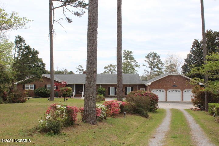 Amazing, Simply Amazing! Sitting on 4.9 acres on Swansboro Water front. Private Living at its best on Dennis Creek with access to the Inland Waterway.  3 Bedrooms 3 full bath, Living room with gas log fireplace, large dining and kitchen area, and huge family room. Off of the living area offers Large Deck and Screened porch facing the waterfront. The master suite has entry to the back deck and porch.  Home includes an oversized 3 car garage.  Beside the garage, there is a barn that would allow ample room all your beach, water toys. The back yard allows for lots of room for entertaining. On Dennis Creek you have a boat dock and private boat ramp.  A must to add to your preview list!