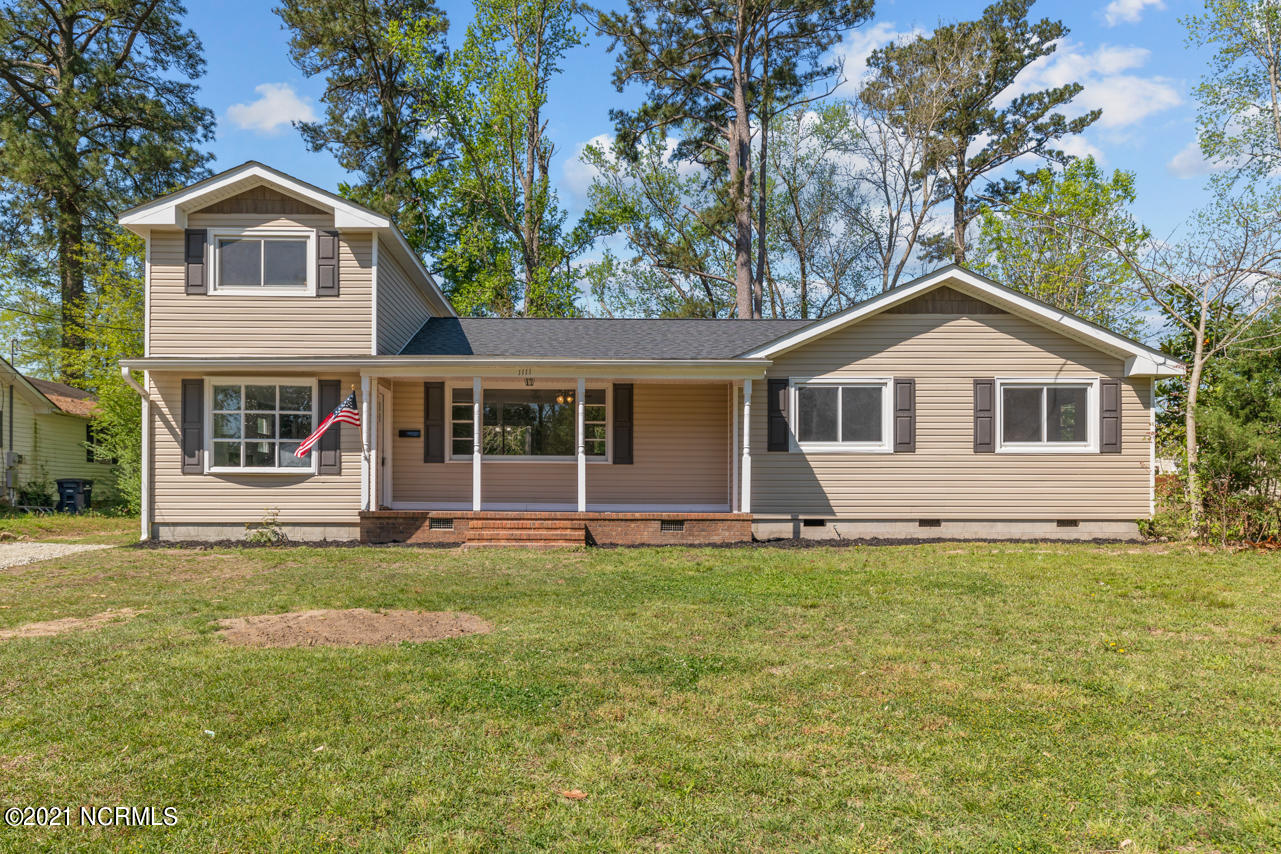 Don't miss out on this beautifully renovated 4 bedroom 2 bath home in the heart of Jacksonville. The home has been completely renovated with a new roof, new flooring, new windows, and gorgeous kitchen with new cabinets, granite countertops, new stainless steel appliances and subway tile backsplash! As you walk in the home you are welcomed by a beautiful bright family room with a fireplace and new laminate flooring. Off the family room is a large laundry/mud room with a utility sink. The gorgeous new kitchen has plenty of space for the baker or chef to cook to their hearts desire. The kitchen opens to the additional living area and big bay window that gives you a nice view of the front yard and lets in an abundance of natural light. The upstairs master bedroom includes an ensuite bath with stylish grey vanity and large walk-in shower. The additional 3 bedrooms are on the opposite end of the home and provide a spacious bright space for all your needs. Schedule your showing today!