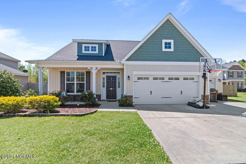 Are you looking for a hidden gem tucked away in a cul de sac in Jacksonville?  We have the one!  Welcome home to 304 First Post Road in the sought-after neighborhood of Towne Pointe.  This four-bedroom home boasts plenty of room for all your family and friends. The kitchen features a spacious island, granite countertops, and stainless-steel appliances.  The living room and dining room are open for a perfect entertaining flow.  The master suite is downstairs, complete with walk in closet and ensuite master bath. Upstairs there are three bedrooms with a loft, and full bath.  The best part is the huge fenced yard that backs up to the pond. Let's not forget the THIRD car garage, too, plenty of room for your cars and all the gear! Sellers are looking to close and rent back until August 1st.  Call us today for your showing!