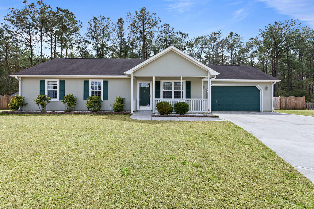 Welcome Home to the Foxlair Subdivision. This 3 Bedroom 2 Bath home is nestled in a cul-de-sac just minutes from local area beaches and the back gates of Camp Lejeune! This home has been meticulously maintained and is move in ready! Many Extras! Living Room features LVP Flooring, Vaulted Smooth Ceilings and Ceiling Fan. Open Bar area separates the Eat In Kitchen. Kitchen has tons of Cabinets and Countertops. Custom Lighting and Newer Kenmore Elite Appliances makes this Kitchen complete. Master Bedroom has Large Closet, Ceiling Fan, Wainscoting and Private Bathroom. Bathroom features Jacuzzi tub and Custom Tile. The remaining bedrooms both have carpet and ceiling fans.   Sliding Glass door leads outside to large wood patio that is perfect for entertaining. This backyard is fully fenced with a double and single gate. Fully wired workshop features shelving with plenty of storage and room for your next project. Call today to make this home yours!