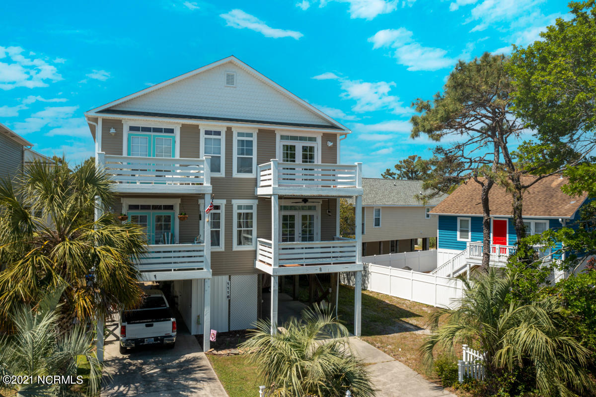 Walk to the beach! Incredible opportunity in serene Carolina Beach. Featuring a first level bedroom, hardwood flooring, stainless steel Samsung appliances, and a deck off of the living room. The 2nd level master suite features another private deck to watch the sunrise or relax with a cold drink after a long day. This home also offers an outdoor shower to rinse off after a fun day on the water. Brand new roof to be installed. The property is being sold furnished(with a few exceptions) and golf cart is also negotiable. Located within walking distance to the Tiki Bar and summer activities. Call today!