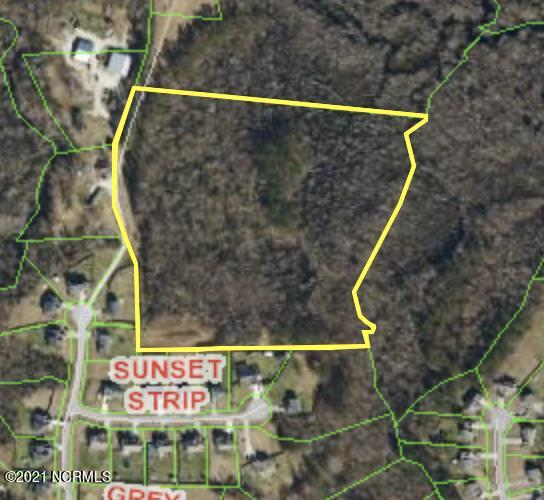 15 acres partially cleared. Property is located adjacent to Dawson Cabin Subdivision. Soil evaluation is complete and shows a 4 bedroom septic.