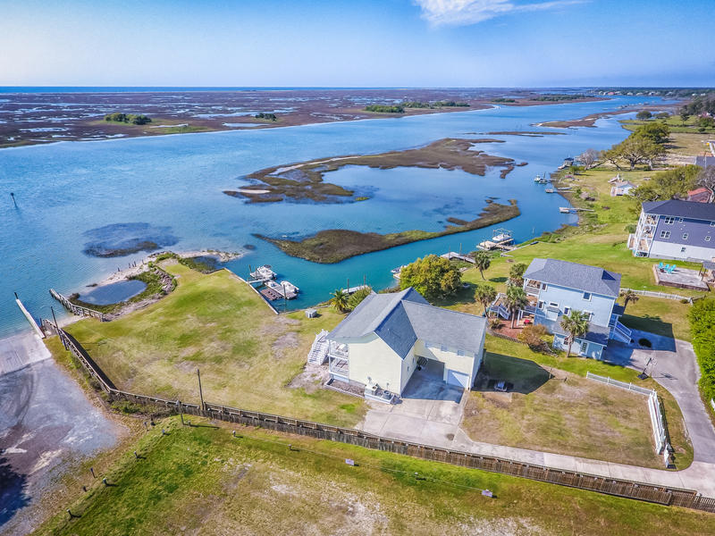 Amazing Intracoastal Waterfront home in the heart of Hampstead!  270 degree water views from Figure Eight Island to Topsail Island with Ocean views from the porches! Very open floor plan that includes a large living room with fireplace and gas logs, huge den, beautiful kitchen with granite countertops and stainless steel appliances, separate bar, waterfront dining area and 4 bedrooms that all face the waterway with sliding glass doors to one of the amazing porches! Expansive porches on both levels that allow you to enjoy the Intracoastal Waterway and Ocean.  Surround sound throughout the home and the porches.  Intercom system too. Copper water pipes.In addition to the amazing home you have a private boat ramp (very rare to have), boat slip or slips (50ft dock with access on both sides)! Electricity at dock if you wanted to add a boat lift.  Could also apply for a CAMA permit and go further into the water for a deeper slip.Plenty of parking on the large lot.  Garage has a gas cooktop and gas heater! Storm windows and Hurricane shutters. 20 ft sliding security gate at top of driveway.One owner home which have never had any water from hurricanes come into the home or garage!  Insurance policies should be transferable. No HOA dues. A private oasis in an awesome location less than 1 mile to grocery, pharmacy, post office and more without getting off of secondary streets!