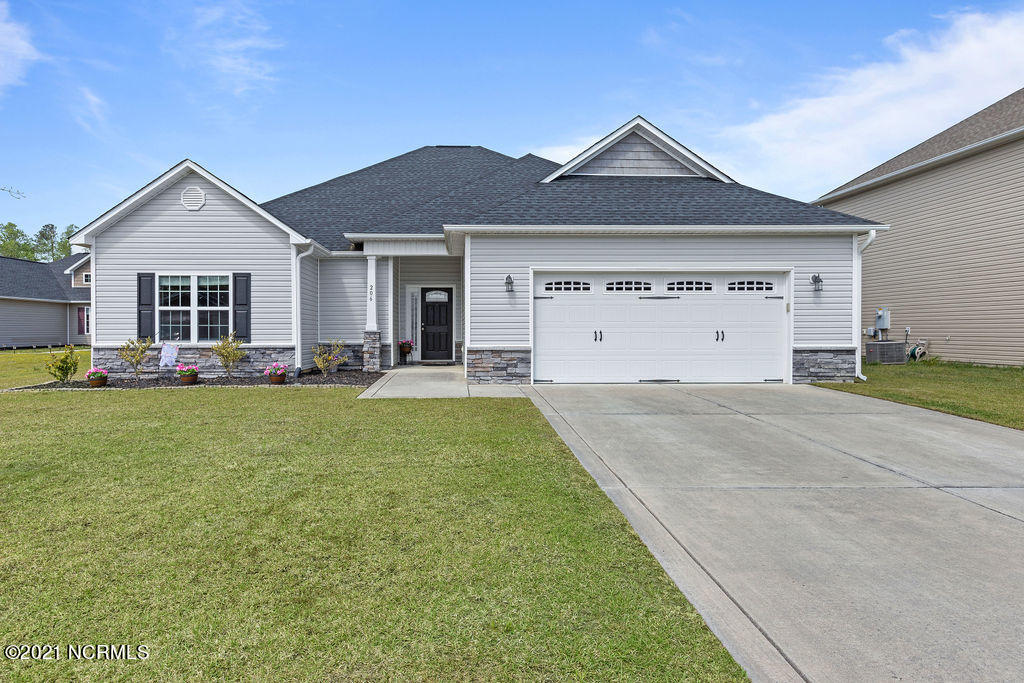 Tucked away in a cul de sac in the popular subdivision of Carolina Plantations, this immaculately maintained 3 bedroom, 2 bath home offers a split floor plan and curb appeal like no other.  The garden is the first thing you will notice walking up the driveway.  Step inside to take in the the vaulted ceilings and ample windows to allow plenty of natural light.  The large kitchen offers enough counter and cabinet space for any chef to feel right at home.   The kitchen opens to the dining nook--the perfect space to sit down for meals as a family.  Off to the right side of the home lies the large master bedroom with a beautiful trey ceiling and his and hers closet.  The master bathroom is humongous, with dual vanities, a stand alone shower, a tub, and a private toilet. This home offers a split floor plan with two more generous bedrooms with enormous walk in closets.  There is no shortage of storage space!Take refuge from the summer heat in the screened in  back porch that overlooks the fenced in backyard.  Zoned to Carolina Forest Elementary--a top rated school in the area. Located outside city limits and convenient to Camp Lejeune and local shopping.