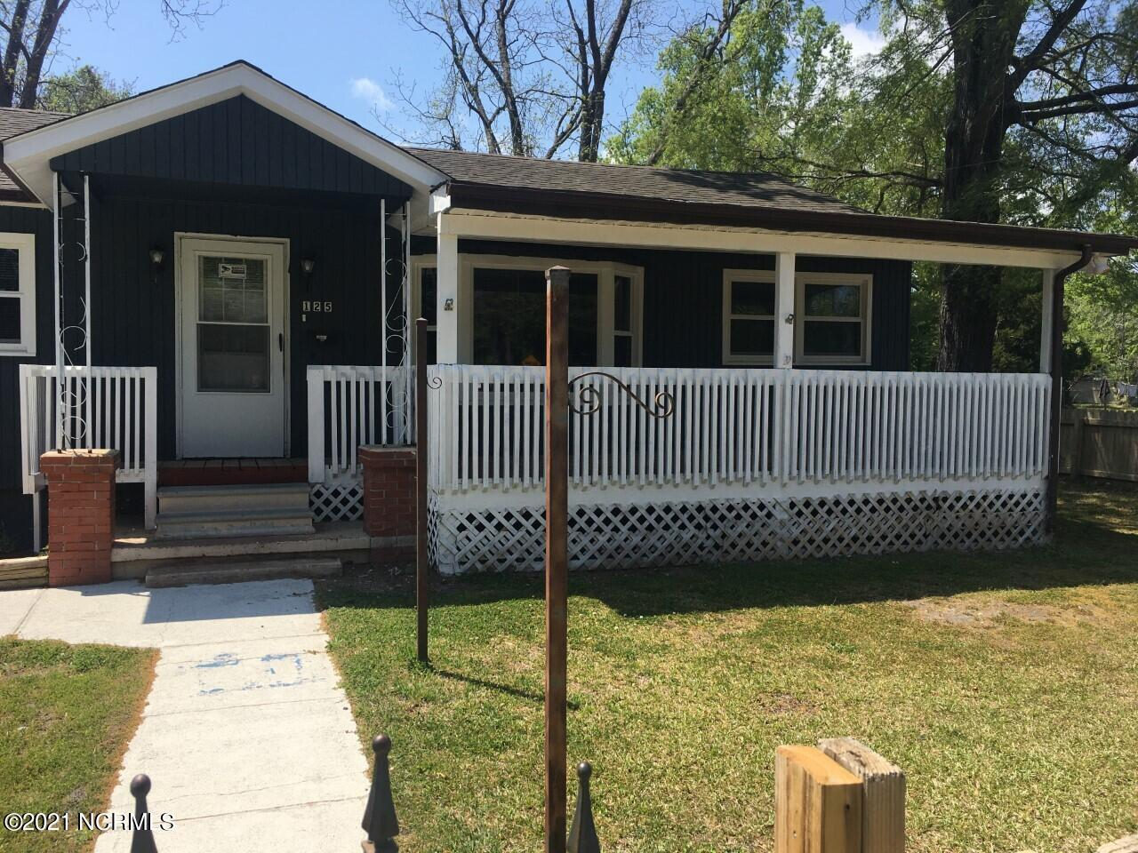 Corner lot, privacy fence, 5 bedroom, 2 bath, enclosed back porch, front porch, privacy fence, detached double car garage.