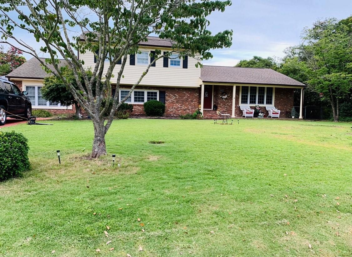 Beautiful, updated home in a quiet, well-established, desirable neighborhood. Located in the heart of Jacksonville, within walking distance of area schools and shopping. Upon entering the main level, you will find an extra-large dining room with built-ins and hardwood floors. The kitchen features beautiful cabinetry, granite countertops, and ceramic backsplash along with stainless-steel appliances. There is an adjacent breakfast area and a bar with additional sink and extra counter space and seating. You will also find a downstairs bedroom and bath, laundry room with washer and dryer (that convey), and a ginormous family room with beautiful floor to ceiling windows letting in natural light to the sunroom. Upstairs you will find 3 large bedrooms and two full bathrooms with granite countertops. The backyard is fenced and there is a large shed with electrical outlets. You will find this home perfect for entertaining family and friends.