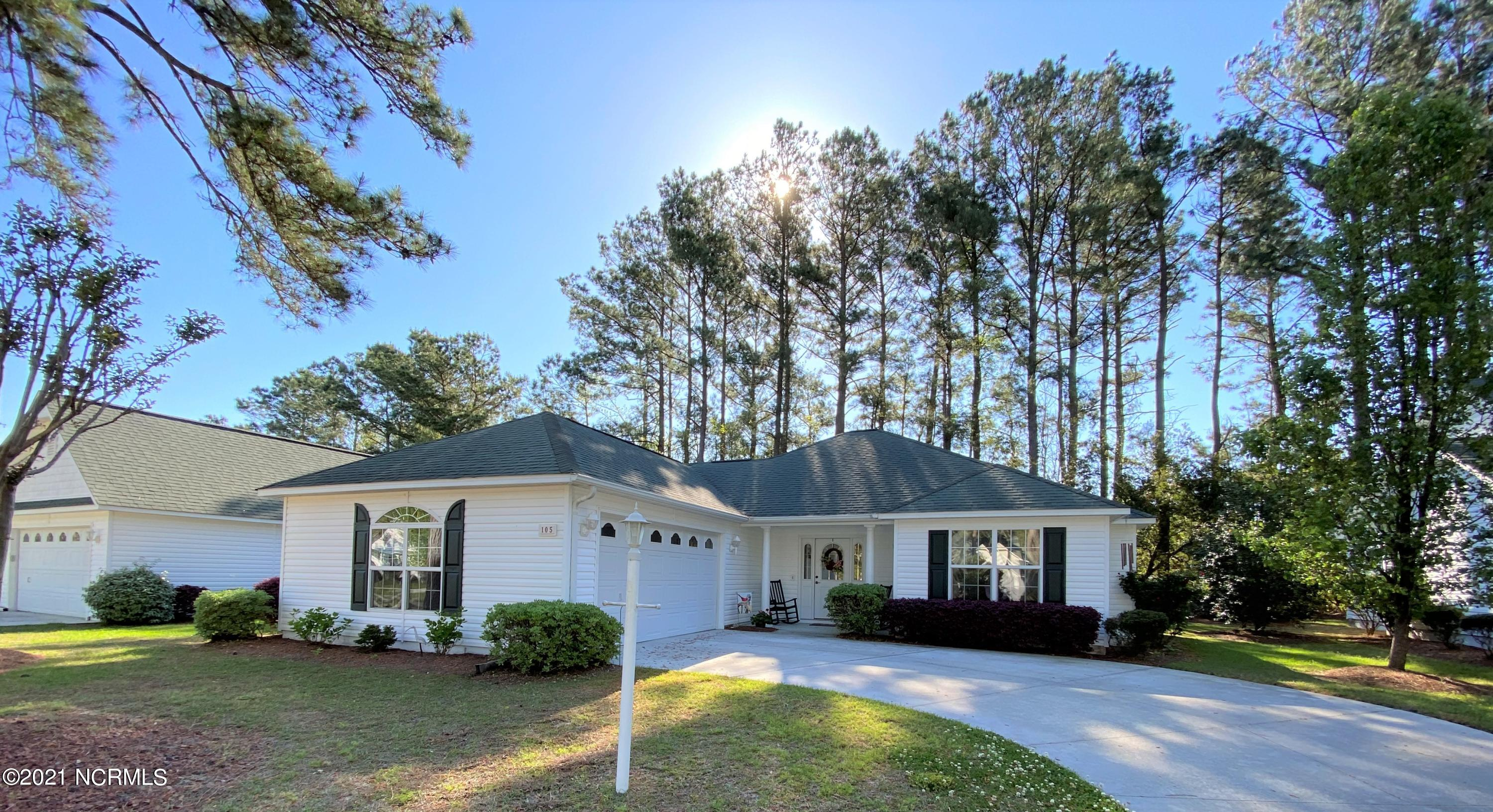Popular 55 & older community of The Villages of Swansboro. Ownership is condominium set up so HOA maintains exterior of homes, yards, & common areas ($245 month)  Pristine 2 bedroom, 2 bathroom home with many updates throughout....recent painting, flooring including laminate/tile/carpet, kitchen granite countertops & tile backsplash, fixtures, master bathroom custom tile shower and more.  All appliances & window treatments convey.  Nice gas log fireplace too! Enjoy a nice screened porch off the kitchen/dining area!  Double garage with cabinets for storage. Original owner has given this home a lot of TLC!