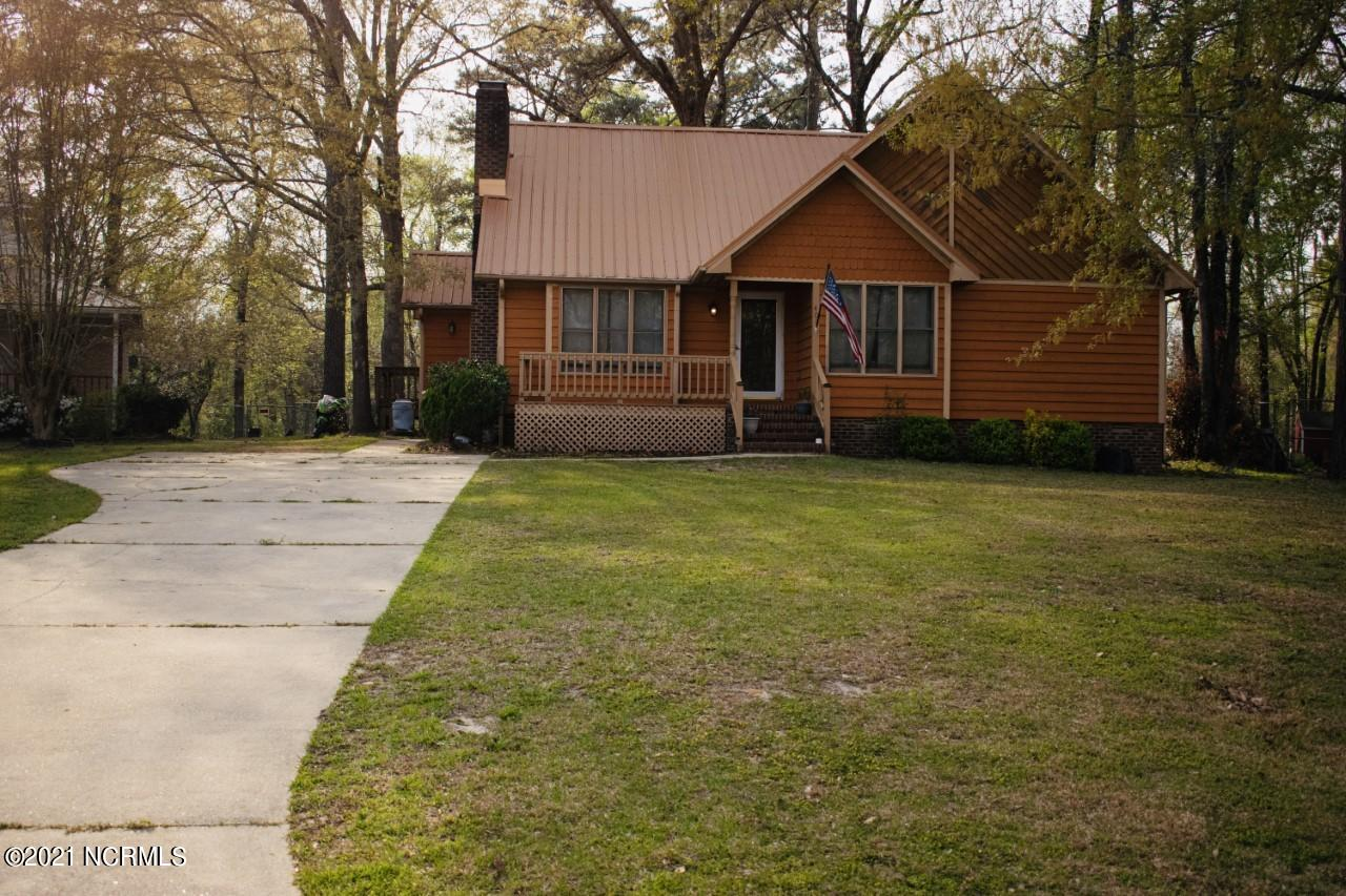 This beautifully distinctive home boasts 3 bedrooms, 2 bathrooms, metal roof, cedar siding, and located on a beautiful wooded lot in a cul-de-sac. As you enter the home you are welcomed into the large family room complete with a cozy wood burning fireplace. The kitchen features an eat-in area with tons of natural light, and a charming island. Make your way out to the backyard built to entertain guests or have a quite picnic, in the yard or on the large deck!