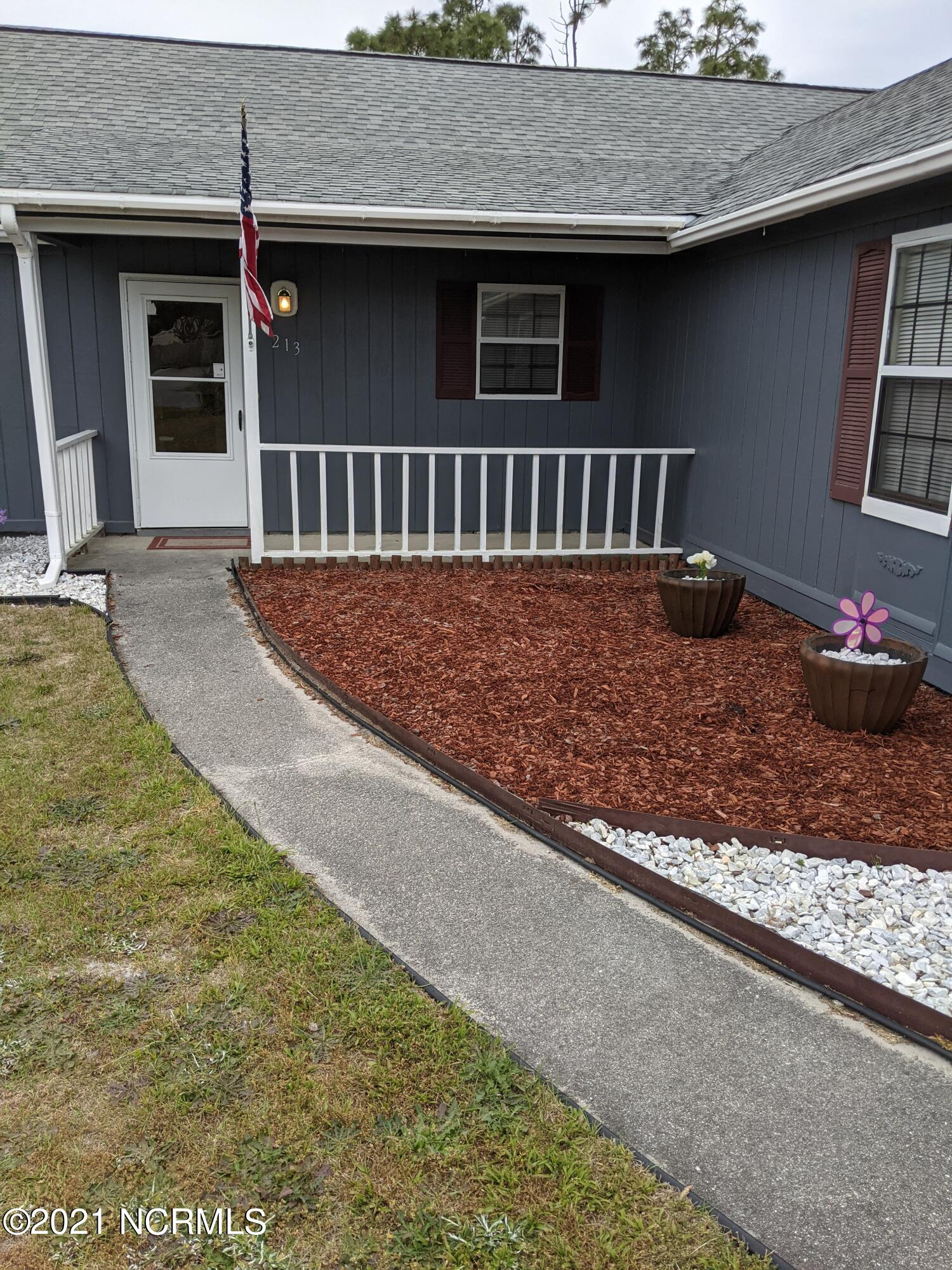 Welcome to Hubert!! This home is renovated and offers Open floor concept , split floor plan with vaulted ceilings , LVP flooring, walk in closet in master, new heat pump, fully fenced in back yard with a large deck for entertaining! the refrigerator in the garage will convey with the house! Get your offers in quick before this gets sold too!!