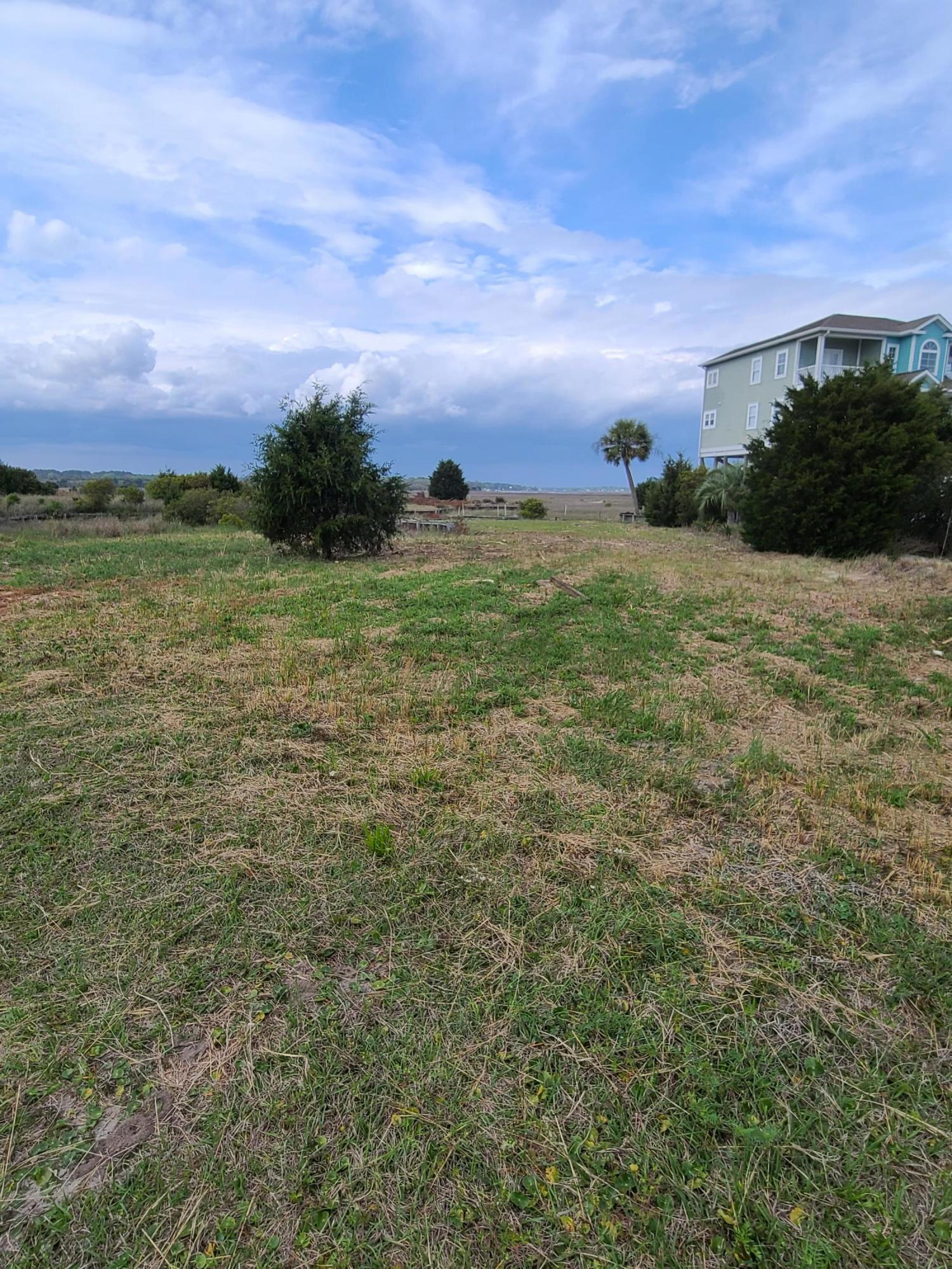 Lovely large 2nd row Beach Lot in Gated Community of Holden Beach West in Phase II BIG 1.04 of an Acre homesite with beautiful Marsh Views and directly across from Private Beach Access. This lot is already bulkheaded. Smaller part of lot in back could be bridged to build garage & possible cofter on top of garage.Holden Beach West is beautiful and you have to see it to understand.