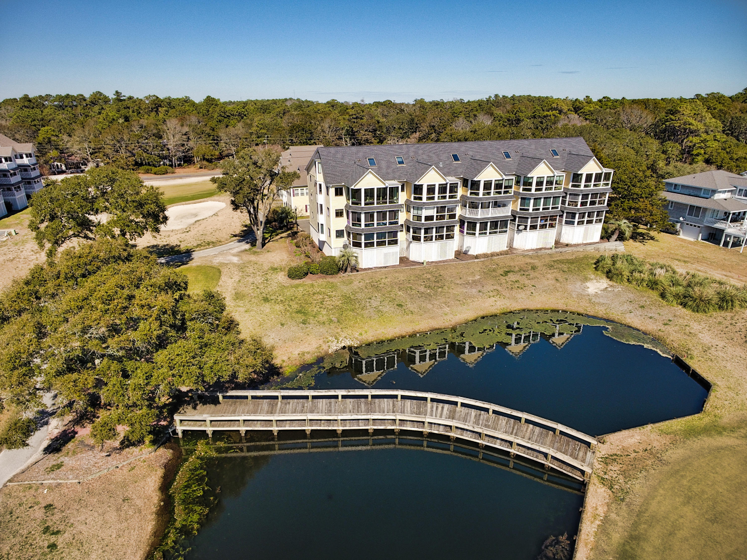 Check out this beautiful spectacular waterfront 2 bedroom 2 bath condo with enclosed sunroom, completely handicapped accessible including shower and bathroom.  This condo is in Inlet Wacche in Brick Landing Plantation in Ocean Isle Beach, NC Views are of the Brick landing fairway # 1 and Green plus the Intracoastal Waterway, and you can see the Shallotte Inlet and Ocean Isle Beach from sunroom.  Spectacular panoramic views. Elevator to second floor makes this a very special condo. Small pool outside your front door and large pool complex inside gates of Brick landing. Beautiful clubhouse. you can walk to for lunch and dinner. Wonderful 18 hole golf course, all shopping, grocery drug stores, retail shopping, nd banking all within 10 minutes away. Ocean Isle Beach, the prettiest family beach in the southeast is only 10 minutes away. New Wildlife boat ramp 5 min. away. Ocean Isle Beach Marina 10 minutes away.  This lovely condo comes partially furnished with sofa, TV's TV cabinet, dining room table with 6 chairs, leather recliner on sunporch, king size bed, one twin bed, washer-dryer, all kitchen appliances. . This beauty will sell quickly,, so call today for an appointment to preview. Never a rental. This special condo has a 12 month Home Warranty that conveys to Buyer at closing, which covers HVAC, Hot Water Heater, all plumbing, all electrical, all built in appliances and refrigerator plus washer & dryer Always used as a vacation get-a-way.  Waterfront Views are panoramic Only 15 units in this complex.