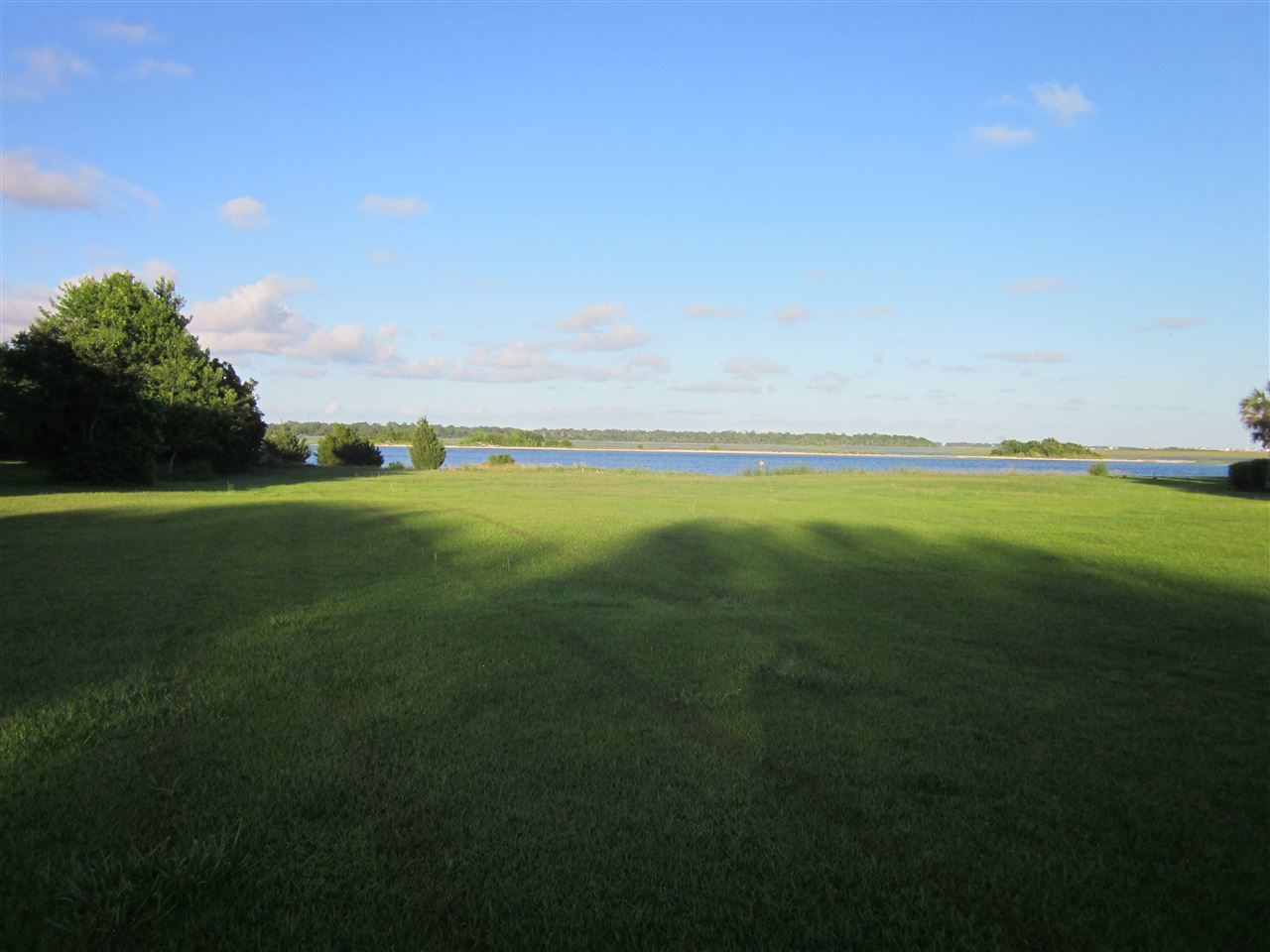 Prime waterfront lot in Hurst Harbor. This lot has fantastic views of Swansboro, Intracoastal Waterway and even some ocean views from Bogue Inlet and also has a private beach on Foster's Bay. This quiet subdivision has it's own boat ramp and dock to the Intracoastal waterway for that person who is ready to enjoy ''''Paradise'''' Swansboro style