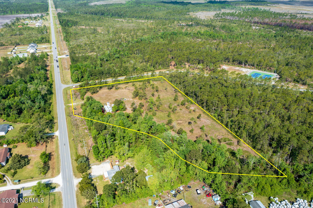 Your next investment opportunity awaits! Featuring over 5 acres of mostly cleared land ready to be developed right beside Stump Sound Park. Sewer main is right across the street. With proper rezoning this would be a great spot for apartment buildings or townhomes. Do not wait, it won't last long!