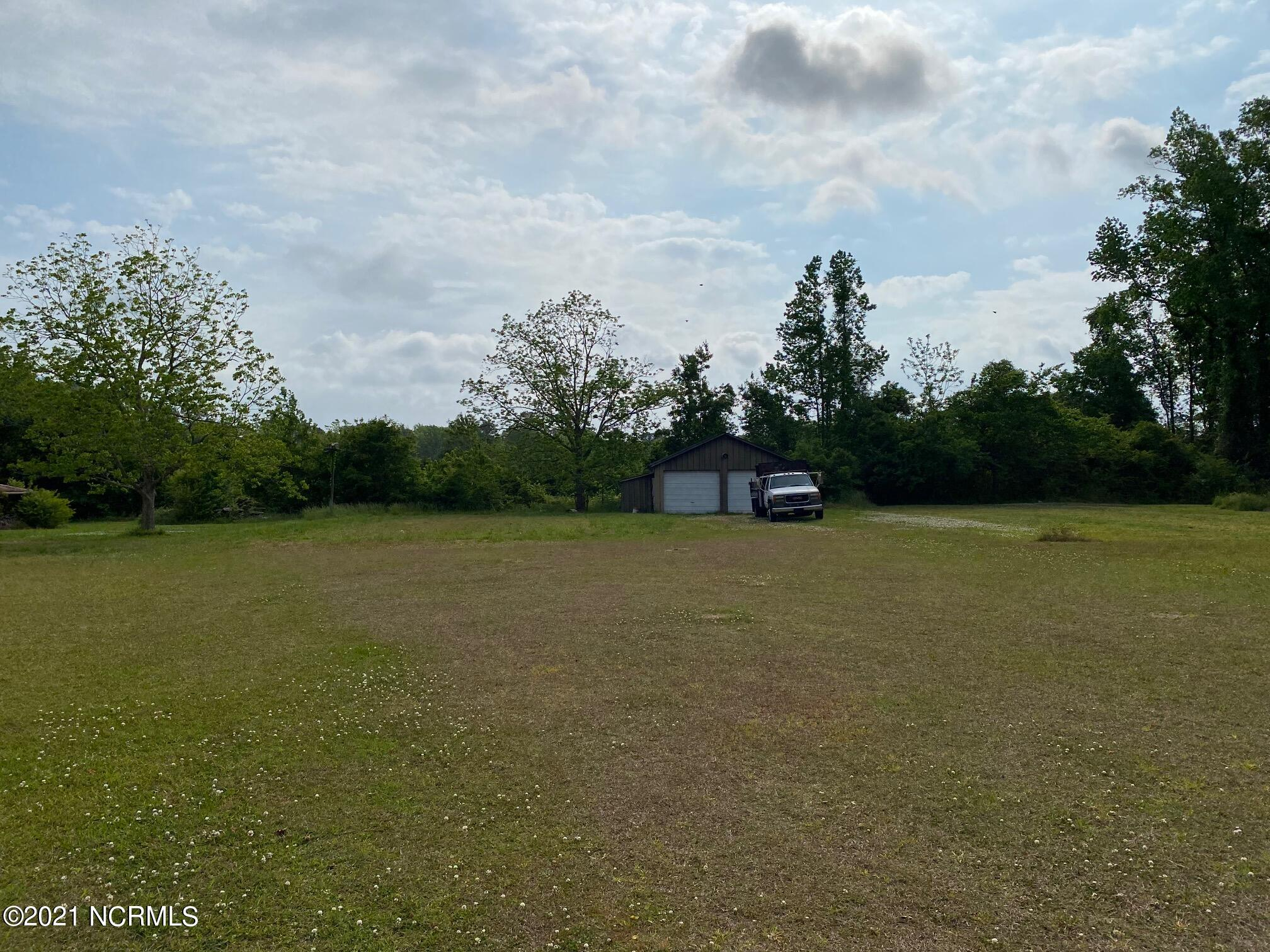 Half acre lot located in a country setting in Verona. The lot is being sold with a 2 car garage that the previous owner used as a workshop. The garage is being sold as-is.