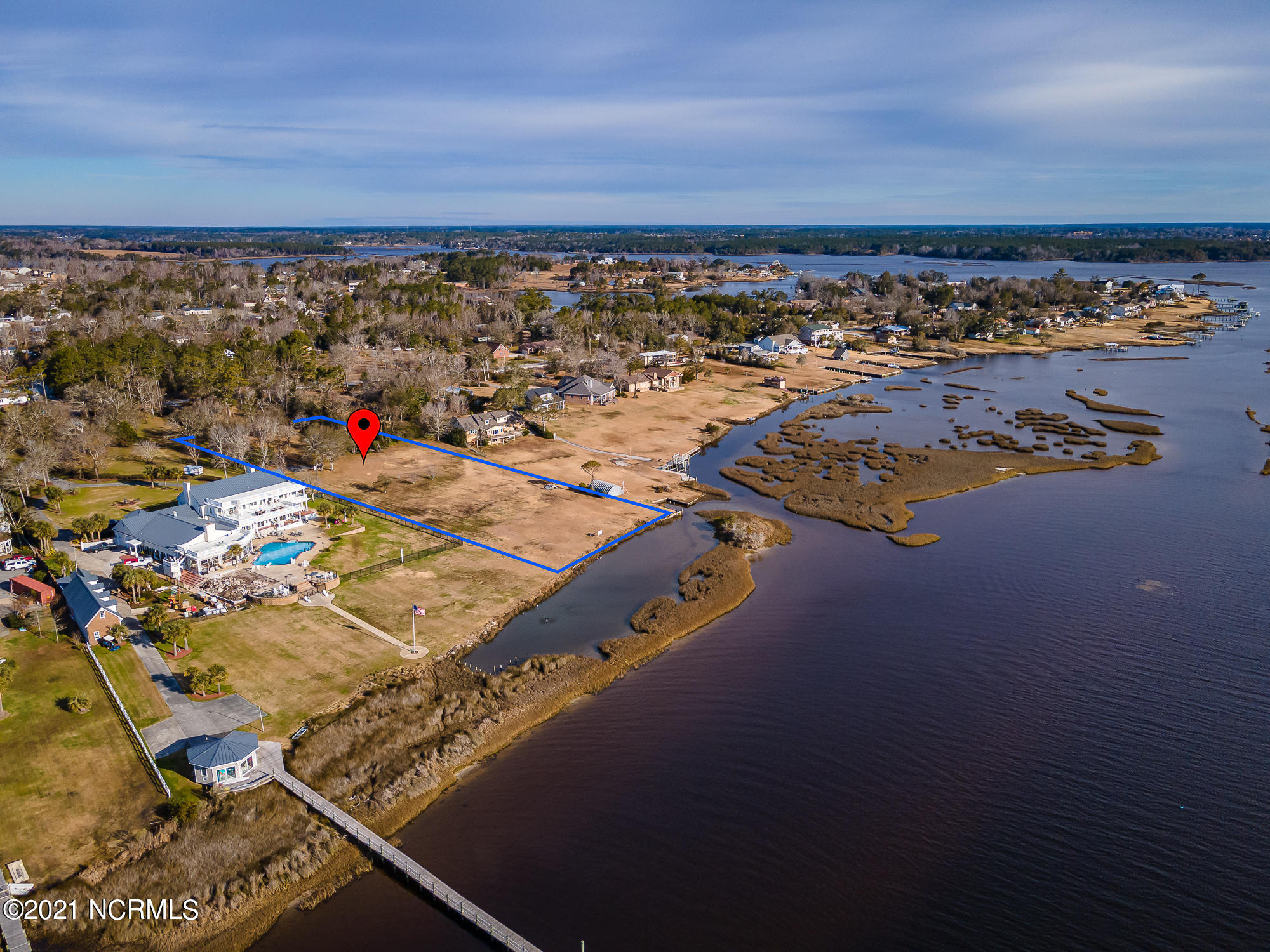 Direct ICWW waterfront property.  This is a rare piece of waterfront with good elevation for a non flood zone build.  The property sits South of Swansboro near the Cow Channel cut to Hammocks Beach State Park.  The existing 2.42 acre lot is in the process of subdivision into 2 lots and this listing is for the East lot. (The one to the left facing the water). Over 1 acre!  Subdivision docs and  septic analysis are being obtained.  Survey shown in the Documents is subject to change based on engineering requirements.  Buyer shall verify Final subdivision plat prior to closing .
