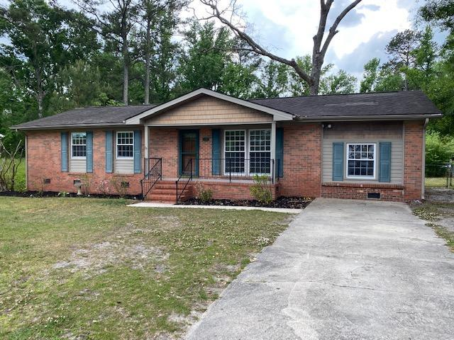 Nice, one story, brick home in the County.  Some hardwood floors.  3 bedrooms, 2 baths with eat in kitchen and converted garage for extra storage.  Large backyard with decks and storage building with lean to.  Come check this one out today before it's gone.