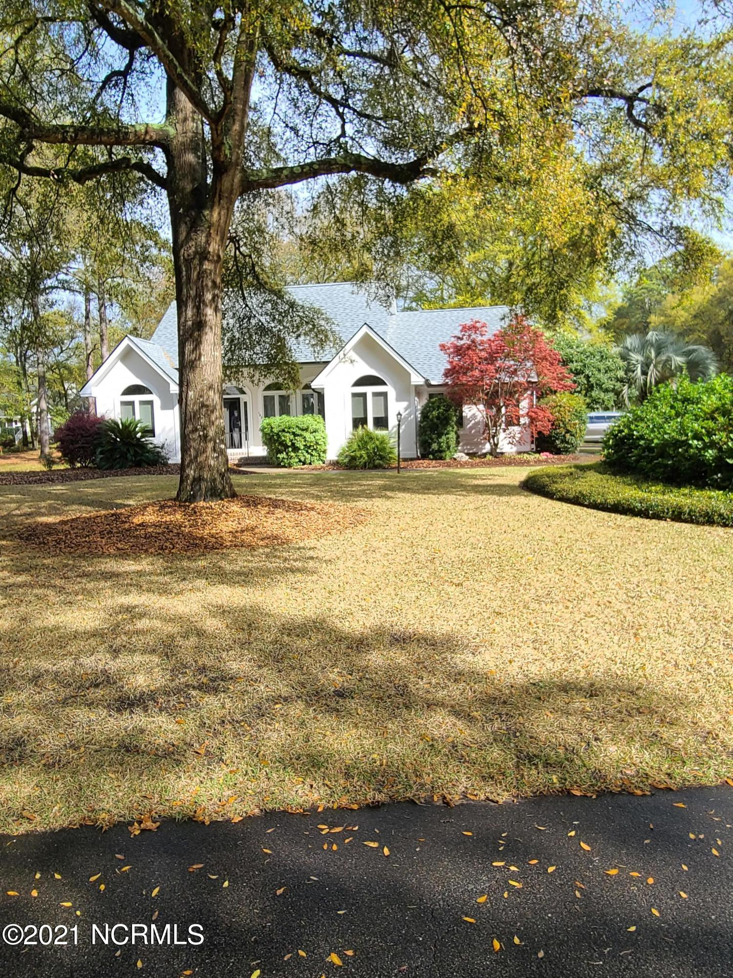 This is It!!  NEW ROOF, gutters. Corian counters in kitchen, custom maple cabinets, Lovely 2,200 heated Sq. feet  custom home on lovely 76 x 155 x 75 x 167 landscaped corner lot with 2-car garage and tremendous uncovered back deck and patio for entertaining. This beauty is in lovely Sea Trail Plantation, which offers excellent amenities and 3 golf courses.  3 bedrooms & 2 baths.  double sided propane gas fireplace, and This wonderful floorplan offers formal living room and Carolina family room, formal dining room and large kitchen dinette area. custom maple kitchen cabinets and lots of them. Craft room over garage. This is a custom-built one owner home built in 2002  New roof! 12 month Home Warranty covering HVAC, Hot water Heater, all appliances including washer-dryer, all electrical and all plumbing. House interior being painted within 2 weeks.  Only 5 minutes to Sunset Beach, a 3 mile long pristine family Beach with no high rises or neon signs. close driving distance to 3 grocery stores and 3 drug stores, retail shopping, restaurants, and fresh seafood market. Can be shown starting June 4, 2021. Vacant, owner moved to Matthews to be close to children. irrigation on well