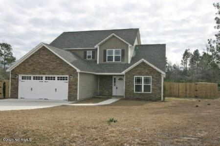 SELLER NOW OFFERING 5,000 BUYER CREDIT TO USE AS YOU CHOOSE! This spacious home, tucked back into Everett Creek Estates, is perfect for anyone looking for a home with water access in the Sneads Ferry area! At over 1,900 sq. feet and built by Onslow County's premier builder, David Wellman, this 4 bedroom/2.5 bath home has all kinds of updated features including a ceramic tile in the kitchen, laundry and bathrooms, a gas fireplace, granite countertops and stainless steel appliances in the kitchen, a formal dining room and a 2 car garage! The living room has vaulted ceilings and is open to a loft area upstairs perfect for a home office or media room! The amazing master suite features a walk in closet, double vanity, separate walk in shower and a garden tub. Whether it's an intimate gathering in the living room, a formal dinner in the dining room or a party that spills out into a gorgeous backyard there is plenty of room to entertain, plus the completely fenced in backyard features privacy fencing and a patio area! Don't miss out on this great opportunity to own a home located in the sought after Dixon school district and close to the beach and back gate of Camp Lejeune!