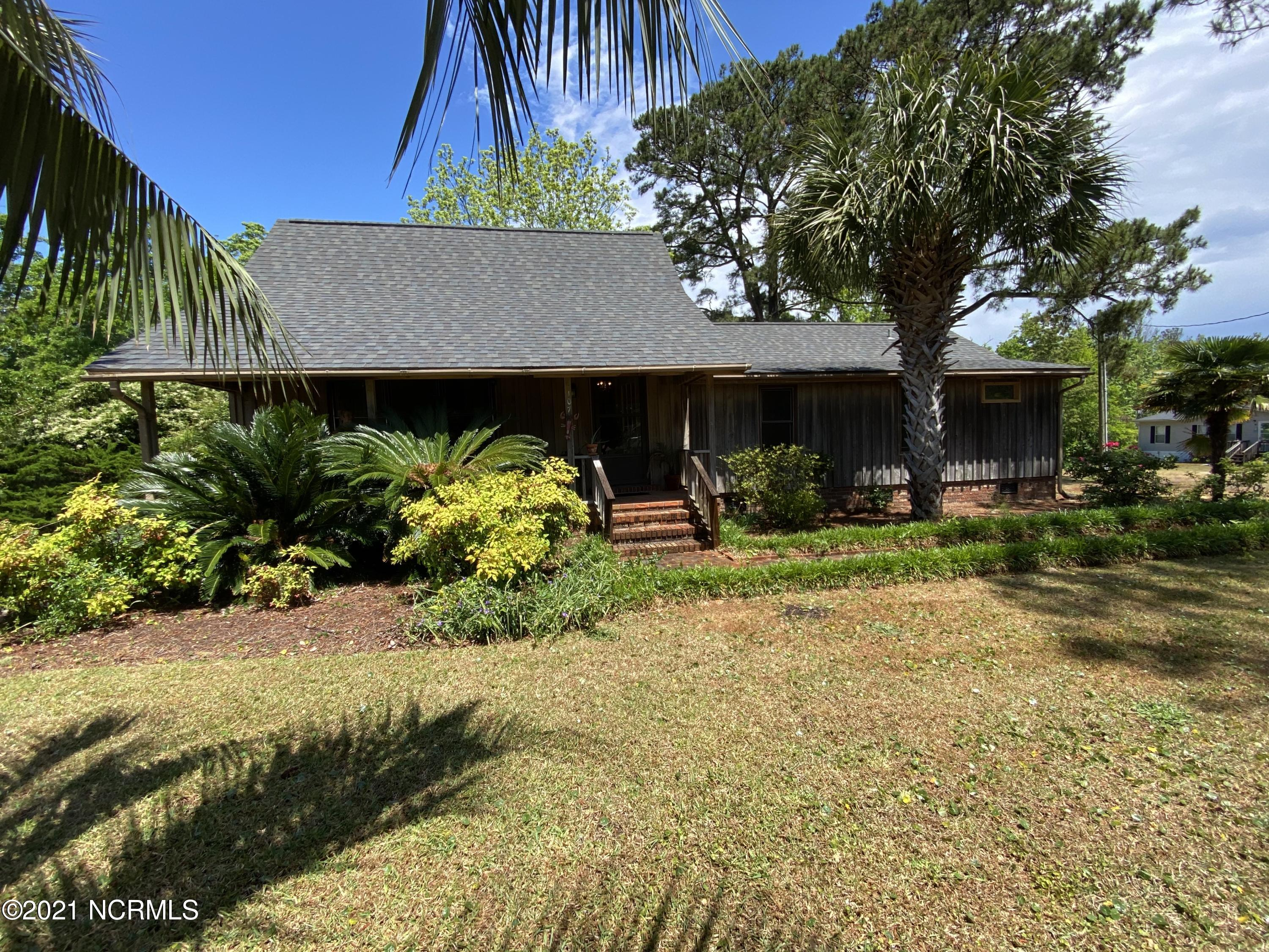 A rare find in the heart of Sneads Ferry, this home is a true gem! Enjoy the peace and tranquillity of coastal living in one of the most unique properties Onslow county has to offer. Secluded on Bumps Creek, this 3 bedroom 2 bath home boasts gorgeous cypress wood siding, wide plank oak flooring, and an ample amount of space and storage. The exterior offers a beautifully shaded front porch, large carport, and a screened in porch, ideal for relaxation. Enjoy those cool summer nights while enjoying views of the canal, Bumps Creek, and the sounds of nature from the natural pond in the back. Call today to schedule your tour