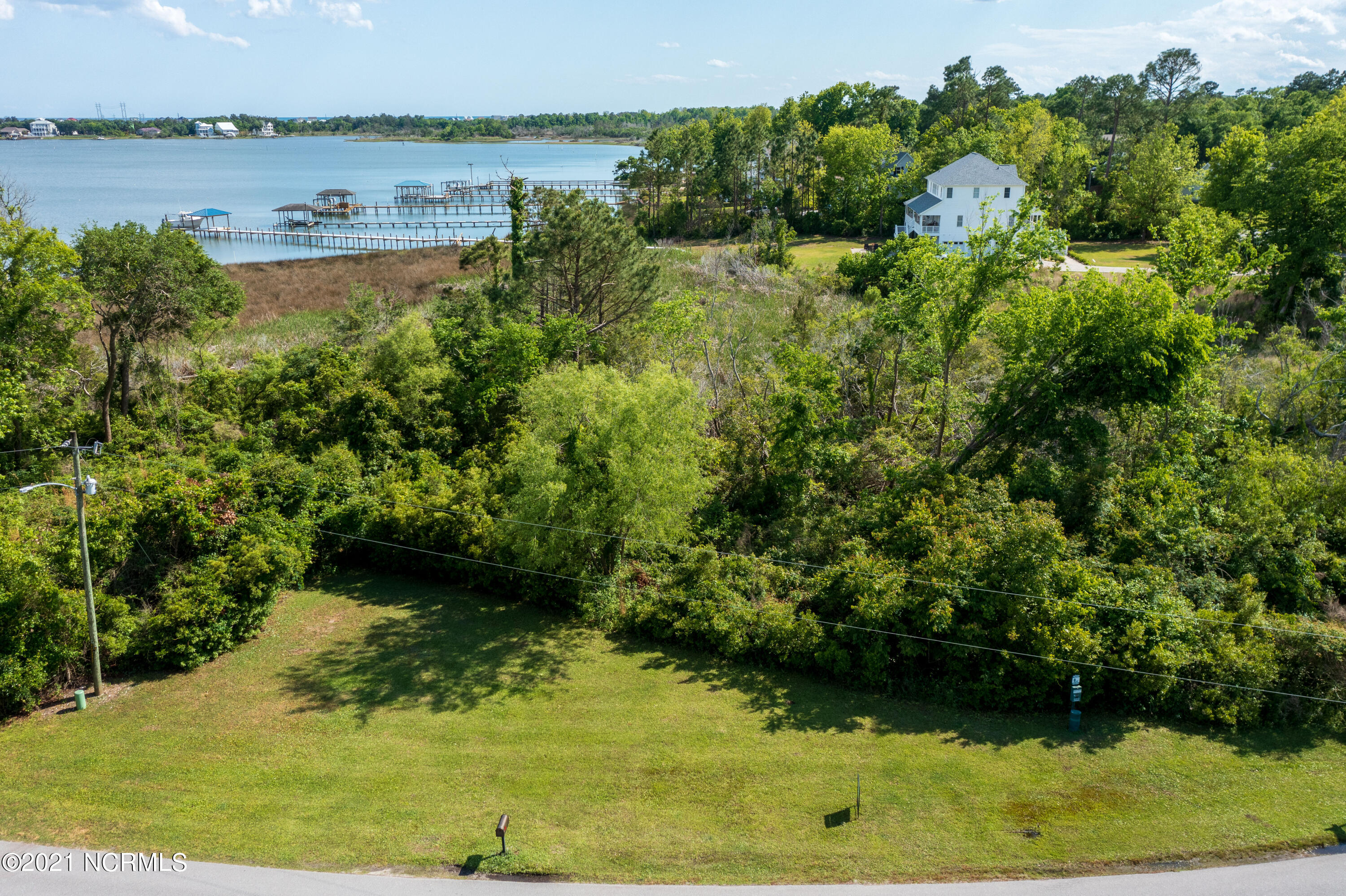 This Waterfront lot on Chadwick Bay overlooking the ICW is priced to sell.   Welcome to the Gated Community of Chadwick Shores that features a community playground and waterfront picnic area with its own day dock.  Community is minutes from Topsail Beaches, MARSOC, Stone Bay, and Surf City.  Easy commute to Jacksonville or Wilmington.   Don't miss this opportunity to own your place on the water.