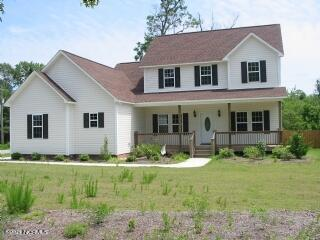 SELLER NOW OFFERING 5,000 BUYER CREDIT TO USE AS YOU CHOOSE! Located across the street from Chadwick Bay in the sought after gated community Chadwick Shores, this home is perfect for anyone looking for a home with water access in the Sneads Ferry area! This home is over 2,000 sq. feet and was built by Onslow County's premier builder, David Wellman. The interior features wood floors in the living and dining room, a gas fireplace, granite countertops and stainless steel appliances in the kitchen, a formal dining room and a 2 car garage! The amazing master suite is located on the first floor and features a double vanity, separate walk in shower and a garden tub. Plus a front porch that WRAPS AROUND to the back means plenty of room for parties that spill out into the spacious fenced in, shaded backyard! Plus you can take advantage of the great amenities at Chadwick Shores, including a playground and a boat dock! Don't miss out on this great opportunity to own a home located in the sought after Dixon school district and close to the beach and back gate of Camp Lejeune!