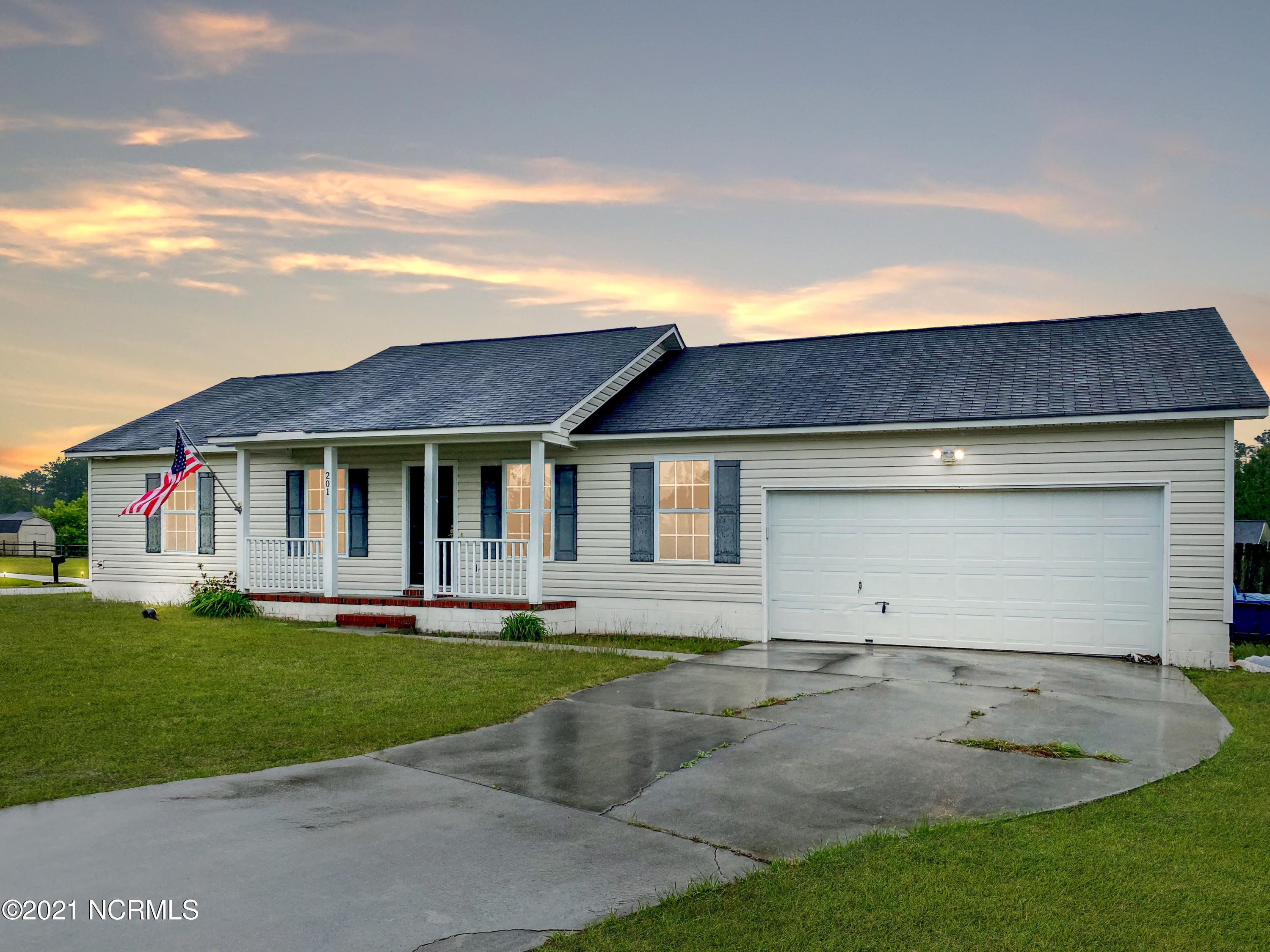 Both a stellar and patriotic location! This home is outside city limits (no city taxes) and on the southern end of the Jacksonville area for a great commute to bases, and, to qualify for lending like USDA and VA loans.  Located on a corner lot of Old Glory Lane and America Court. The sunny, dine-in kitchen opens to a large fenced yard and open deck. Oversized great room greets you at the entry, a generous sized master suite and two more bedrooms and hall bath on the left. Gracious front porch to enjoy the view. Tenants finally out. Power wash, carpet cleaning and move out clean complete. Interior painting going on now, agreeable grey. Heat pump is one year old.