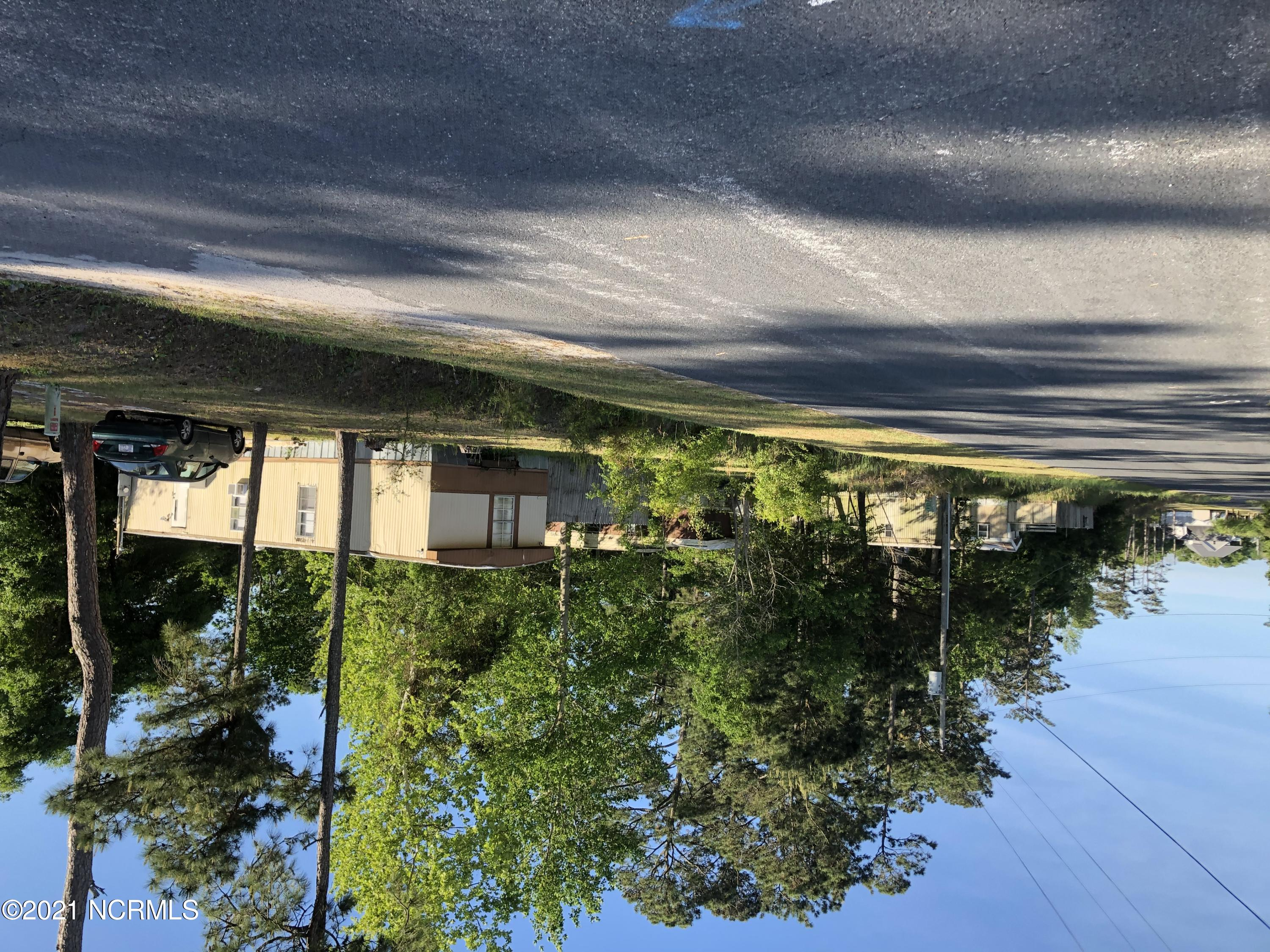 Land used as mobile home park could be bought for several building lots. Located in nice neighborhood. Just a short drive to boat ramps, beaches and shopping. No city taxes.