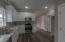Gorgeous White Cabinets, Beautiful LVP Flooring in the Kitchen. Great Counter Space and lots of Cabinetry Space. Recessed Lighting.