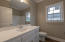 Hall Bathroom, Marble Counter Top, White Cabinets, Shower/Tub Combo.