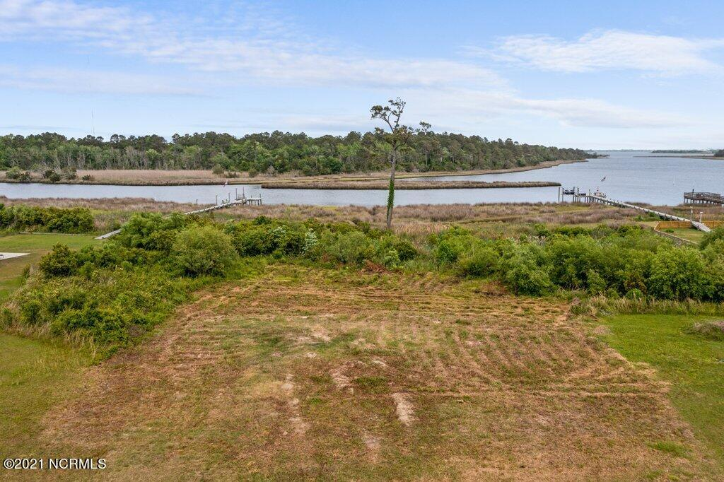 This is the perfect lot to build the house and life you've been dreaming of. Located in King's Harbor sub-division with expansive coastal views  This scenic lot touches Kings Creek with a view of  Spicer Bay along the ICW.  Enjoy the cool breeze of  of sunsets. overlooking the waterway. Imagine the ease of pulling  up your boat when you build private deep-water dock. Expired Septic plan for a 3 bedroom home. Please note lot for sale is the one in the middle of photos.
