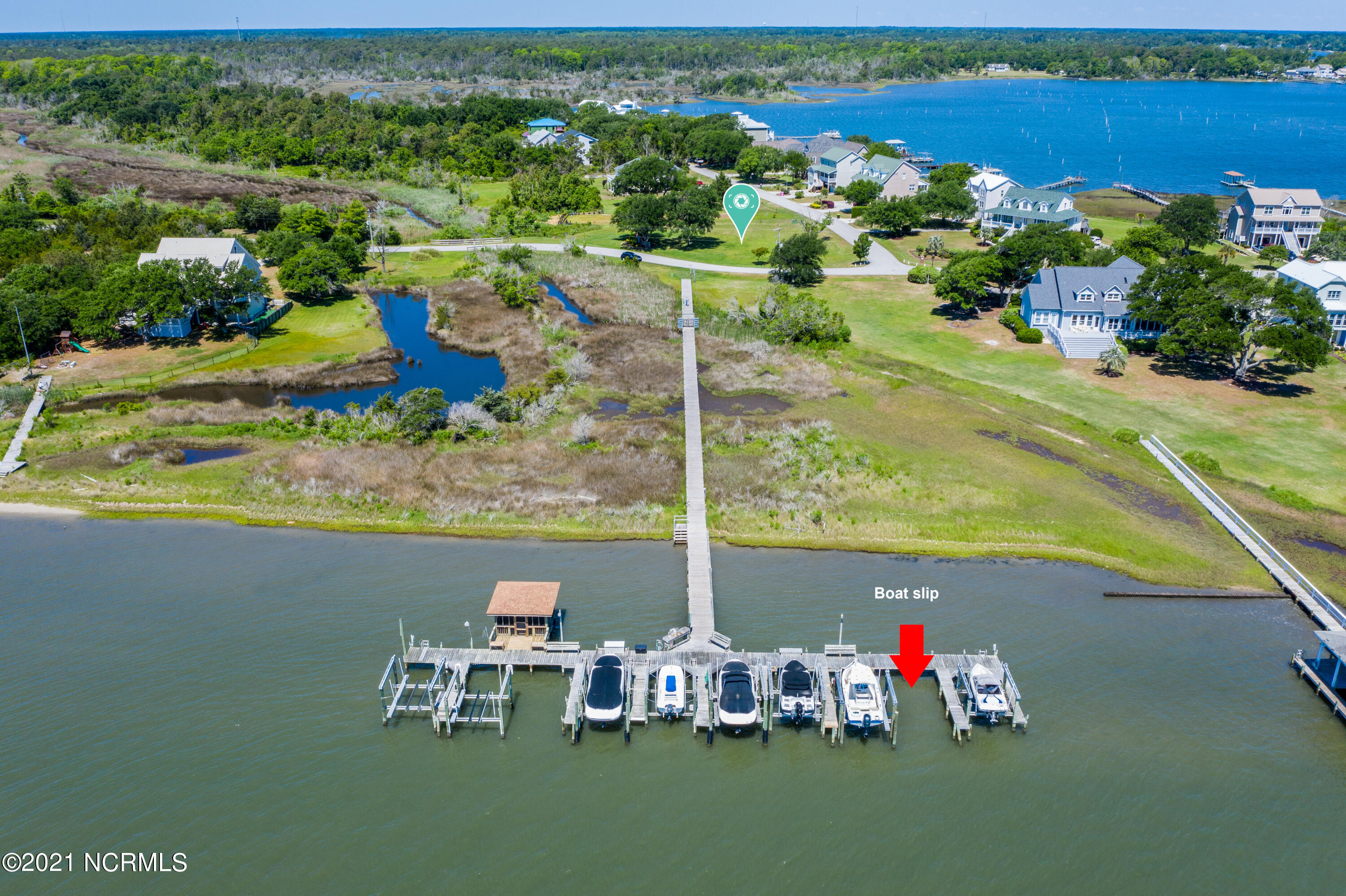 Are you ready for summer boating? This lot comes with a Deep Water Boat Slip on the Intracoastal Waterway! Build your dream home on this lot with a view of the ICW in the prestigious coastal community of Pelican Point.  This is a gorgeous corner lot with no city taxes to worry about. If you are not quite ready to build that's ok, park your boat and enjoy your boat slip while you plan for your future coastal oasis.  This unique opportunity won't last - check it out today.