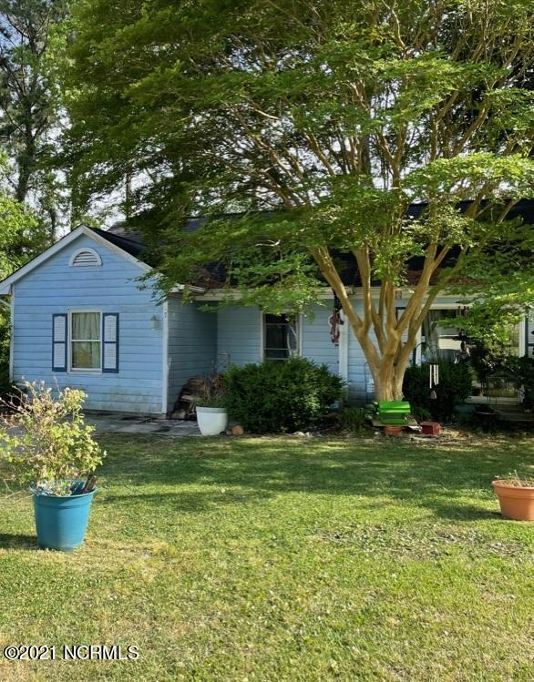 Cozy ranch-style house in safe neighborhood, secluded at end of cul-de-sac. Just minutes to Camp Lejeune, plus quick and easy access to all of Jacksonville, including schools. Beautiful park with playground & pavilion just beyond back yard! House comes with Kenmore fridge, stove, washer & dryer, and dishwasher. Living room has an elegant vaulted ceiling and wood-burning fire place! Gorgeous hardwood floors through out most of the house! Double-pane windows installed throughout the house. The 30 year architecture-shingled roof is just 10 years old.  Lots of closet and attic storage space, and the garage was converted into a 4th bedroom for even more storage, if wanted.  Less than 5 minutes from Jacksonville Middle School, and Jacksonville HIgh School. Huge fenced in back yard. The house even has a cute little doggie door that connects to the back patio. Storage shed in back yard. Great location, and very quiet neighborhood. House sets very close to the boat launch at Northeast creek park too! Just an all-around convenient & well-maintained house that's fun to live in!