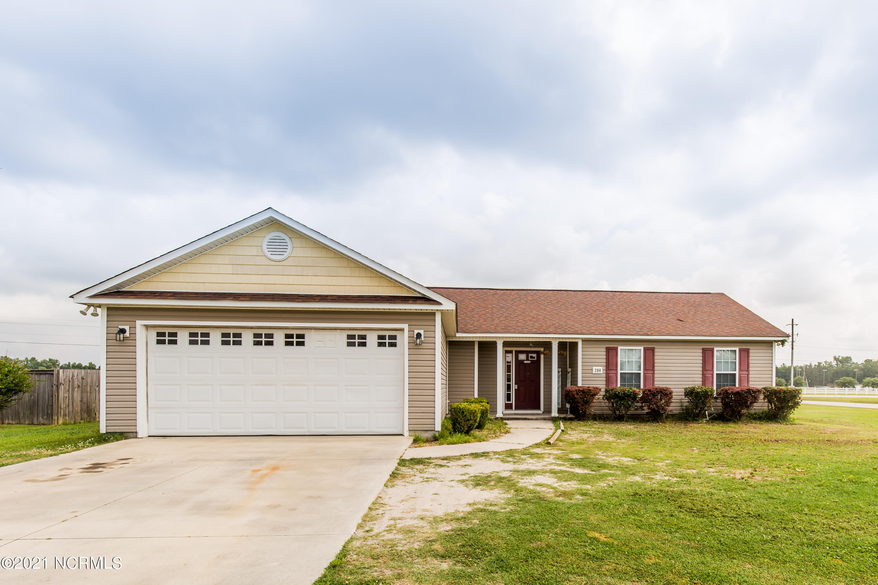 Beautiful 4 bedroom, 2 bath home outside city limits! Looking for space, this home sits on a corner lot on just over half and acre. Open living area with lots of natural light. Master bedroom has a walk-in closet, private ensuite with dual vanity. New carpet recently installed. New paint. Call today to schedule a showing.