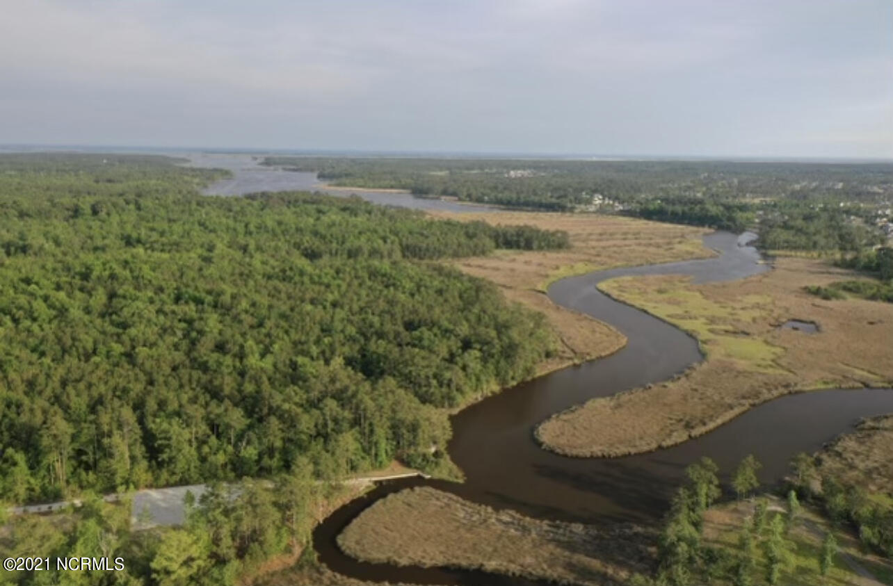 Build your dream home on a 1.8 acre waterfront lot with direct access to Queen's Creek!  This wooded lot declares serene privacy and is exceptionally higher than neighboring properties.  The water view from this natural ridge gives an extraordinary perspective over looking Brunettes Branch and Queen's Creek.  A 4-Bedroom conventional septic system is already installed. A private dock may be installed on the property for the convenience of boating to and from home.  However, the neighborhood boat ramp and day dock also makes days out on the water easy with a deep water boat ramp.  If you enjoy watching sunset after sunset over the water, fishing in your back yard, or simply boating to the sandy islands nearby this lot is for you!  Bohicket Landing is in close proximity to the surrounding military bases including MCB Camp LeJeune, Cherry Point and New River Air Station. Located just off Highway 24, this  waterfront lot provides an easy drive to beaches, shopping and schools.  This is a MUST SEE Lot.