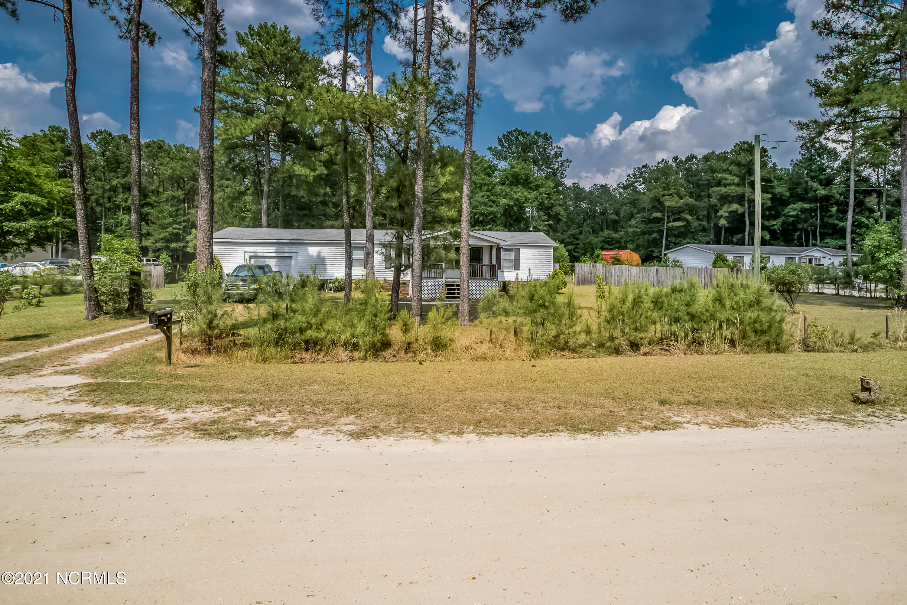 A remarkable opportunity for someone who needs everything!  This lovely 3 bedroom 2 bath manufactured home on a solid brick foundation comes fully furnished!  New Jenn Air indoor griddle and flat top stove, built in oven, and all appliances will convey with the sale.  Enjoy your peaceful evenings on the covered front porch or the back deck while looking in to the nicely manicured yard with fruit trees and grape vines.  If county living is what you want, look no further!  This home has it all!