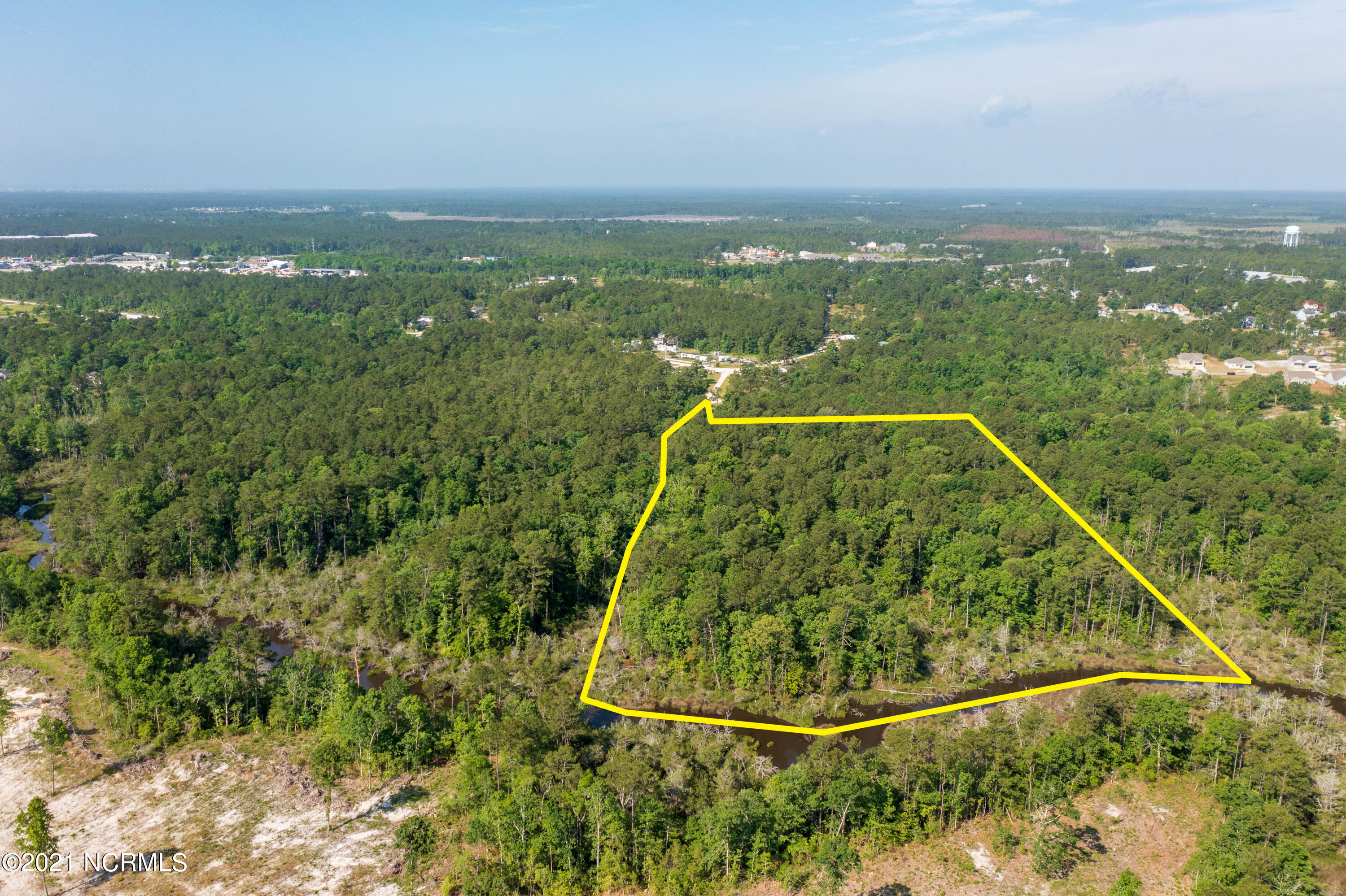 Offering 10+ acres in Sneads Ferry with over 600 ft of water frontage! This lot is tucked away offering tons of privacy to build your waterfront dream home!