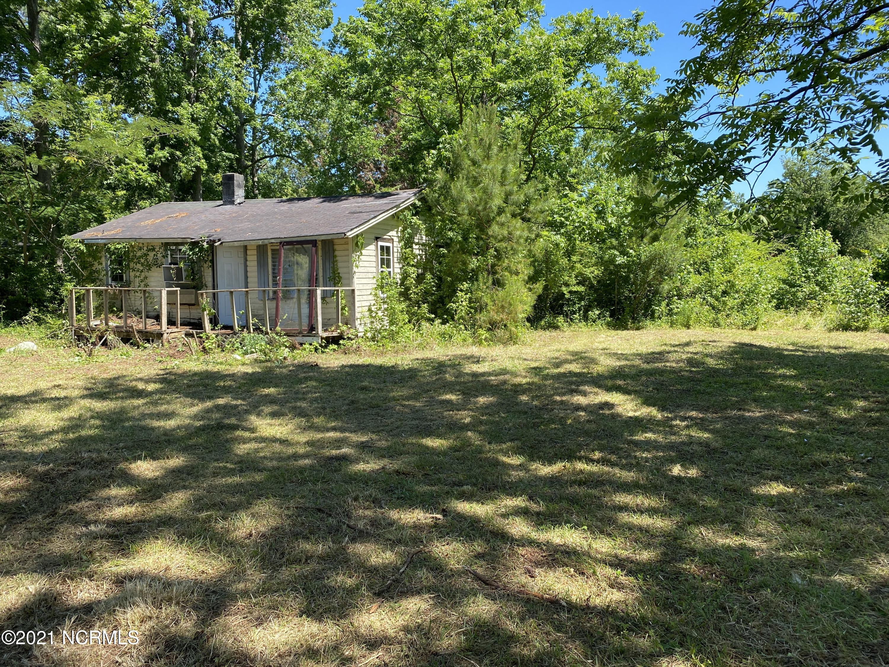 A perfect lot to build a  home or place your manufactured home.  There is an old septic permit on file from 1988.  The lot has an old dilapidated home on it. Come check it out