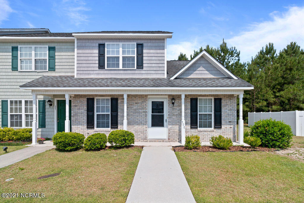LOCATION LOCATION! Carolina Forrest!! MOVE-IN READY!!  Clean, Fresh Paint, Excellent Condition, Spacious THREE BEDROOMS, THREE BATHROOMS, Covered Screened in Patio with Utility Room Access.Conveniently located Laundry just off the Kitchen.  Enjoy your Open Bar Window from Kitchen to Living Room. 2 Designated Car parking just outside your door.  Quiet Neighborhood yet Near Schools, Shopping, Theaters, Parks, you name it...it's at your fingertips.  A Must See!!