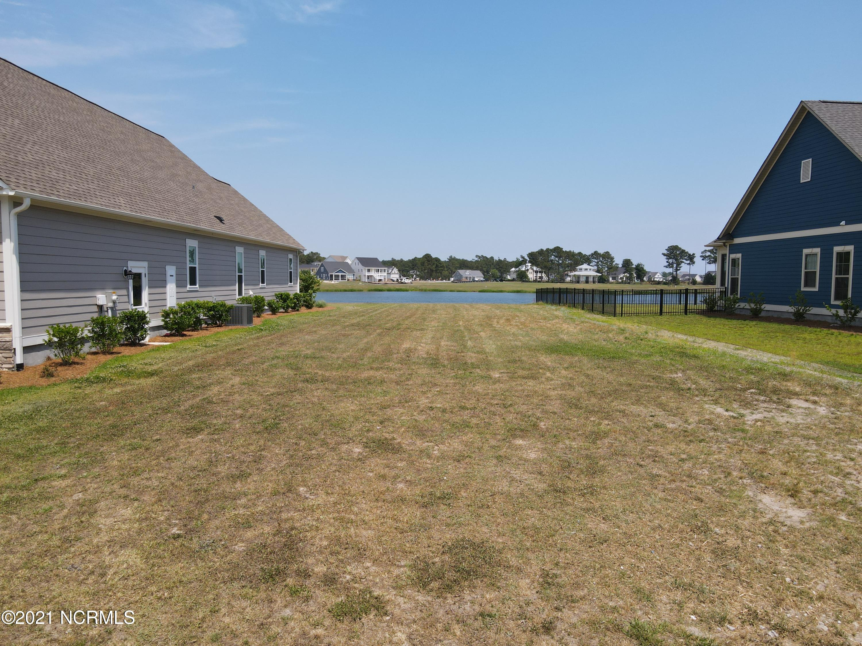 Vacant homesite, ready to build in luxury waterfront community of Summerhouse on Everett Bay!  All the amenities are in place in this idyllic neighborhood, featuring a huge clubhouse, pool, fitness center, day docks, boat ramp, boat storage, pickle-ball court, tennis court, basketball court, running trails, playground, and more! With our Featured Builders, you can design your coastal home and start living the beach life in no time!  10' Drainage Easement - east side of the lot. Call today for more information!