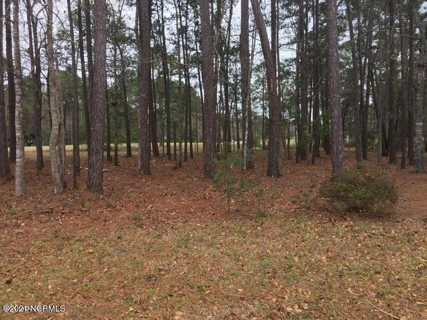 Lovely wooded lot looking at the Fairway of Carolina Shores Golf Course. Located just about 15 minutes from Crow Creek, Brunswick Plantation, Lions Paw, and many more Professional Golf Courses.  Just 5 minutes from the quaint fishing village of Calabash. and a short drive to Beaches, entertainment, restaurants, shopping and about 25 minutes from Myrtle Beach.